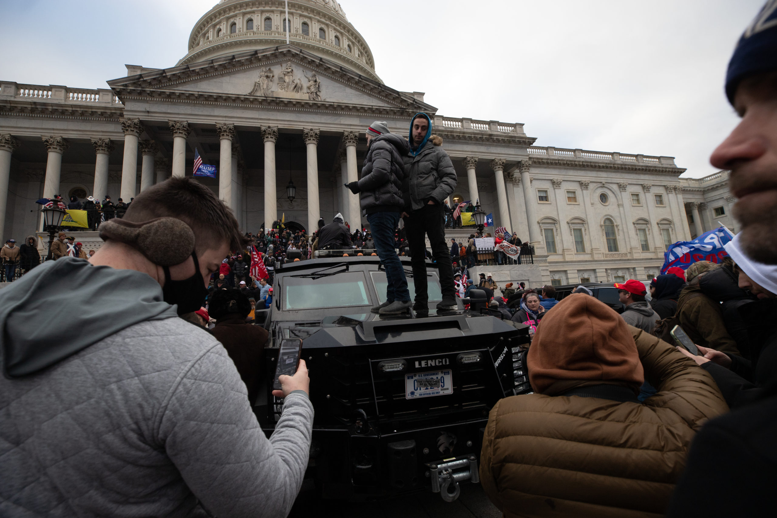 A man stands on top of a police vehicle outside of the U.S. Capitol on Wednesday amidst a riot. (Kaylee Greenlee/Daily Caller News Foundation )