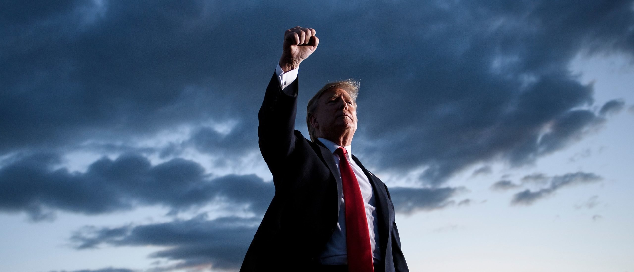 TOPSHOT - US President Donald Trump holds up his fist as he leaves after speaking during a Make America Great Again rally at Williamsport Regional Airport May 20, 2019, in Montoursville, Pennsylvania. (Photo by Brendan Smialowski / AFP) (Photo by BRENDAN SMIALOWSKI/AFP via Getty Images)