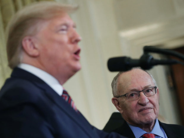 Alan Dershowitz listens to U.S. President Donald Trump speak during a Hanukkah Reception in the East Room of the White House on December 11, 2019