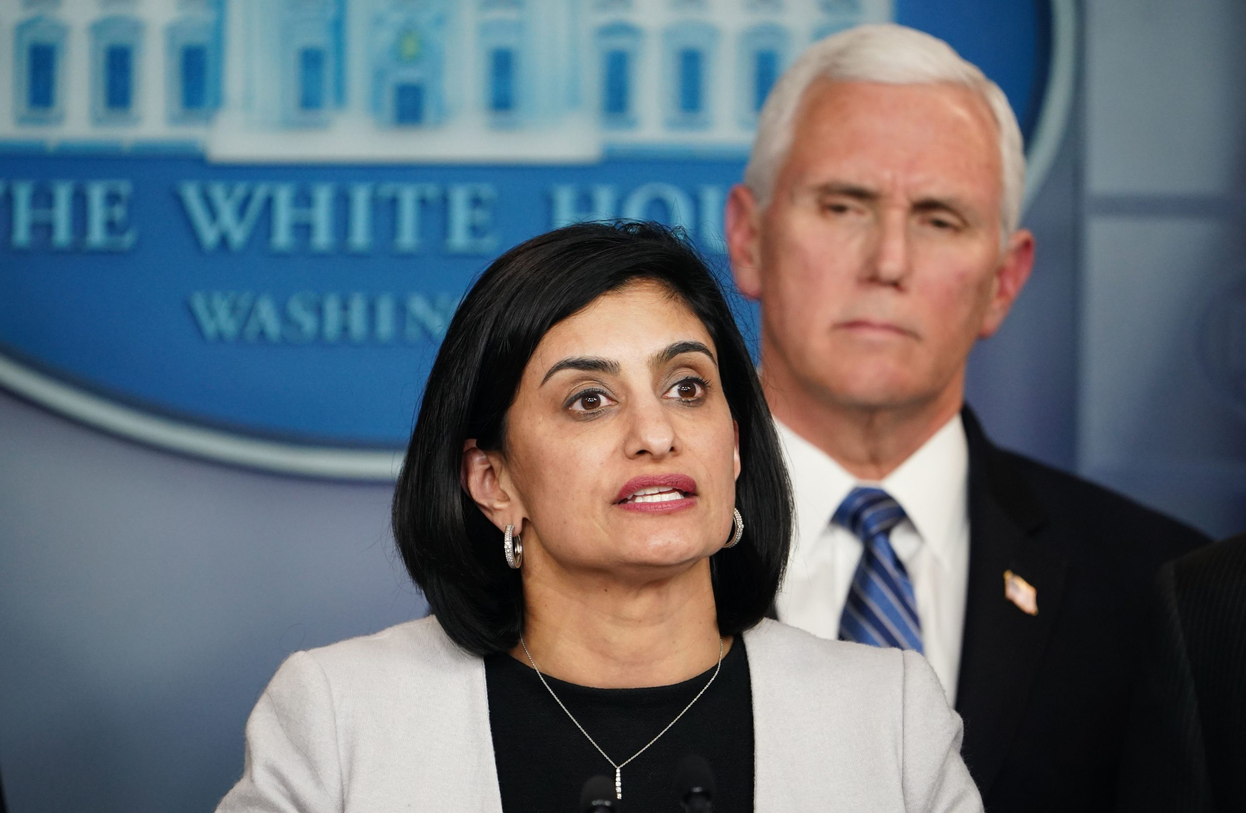 Seema Verma, administrator of the Centers for Medicare and Medicaid Services, and US Vice President Mike Pence (R) speak along with members of the coronavirus take force during a press briefing at the White House in Washington, DC on March 2, 2020. (Photo by MANDEL NGAN/AFP via Getty Images)