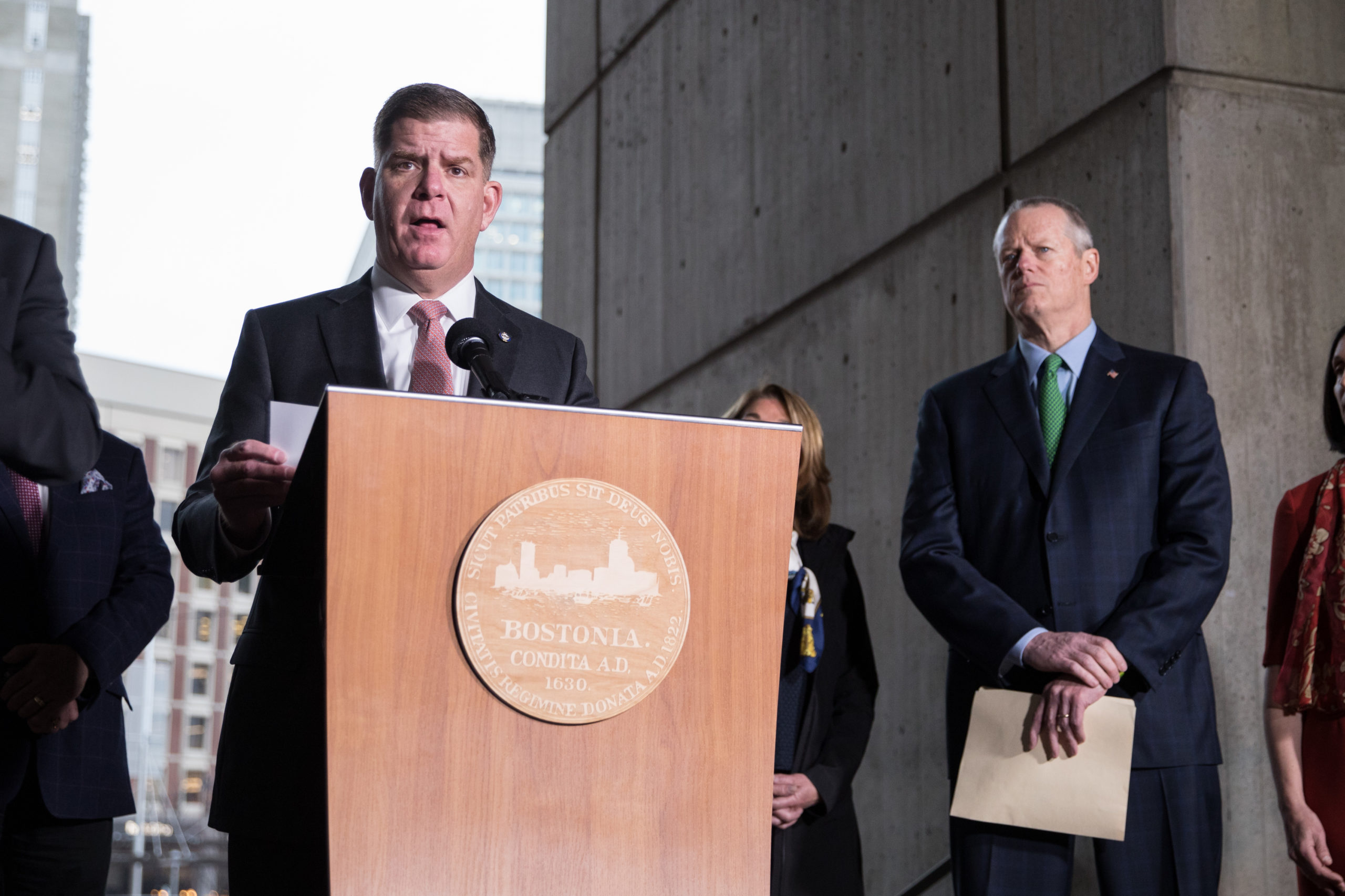 Boston Mayor Marty Walsh, joined by other officials, speaks at a press conference in March. (Scott Eisen/Getty Images)
