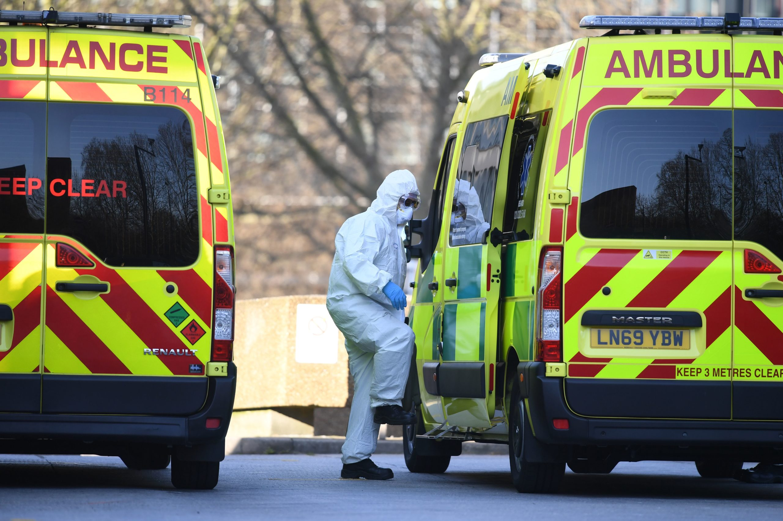 A member of the U.K. ambulance service wearing personal protective equipment is seen in March 2020. (Daniel Leal-Olivas/AFP via Getty Images)