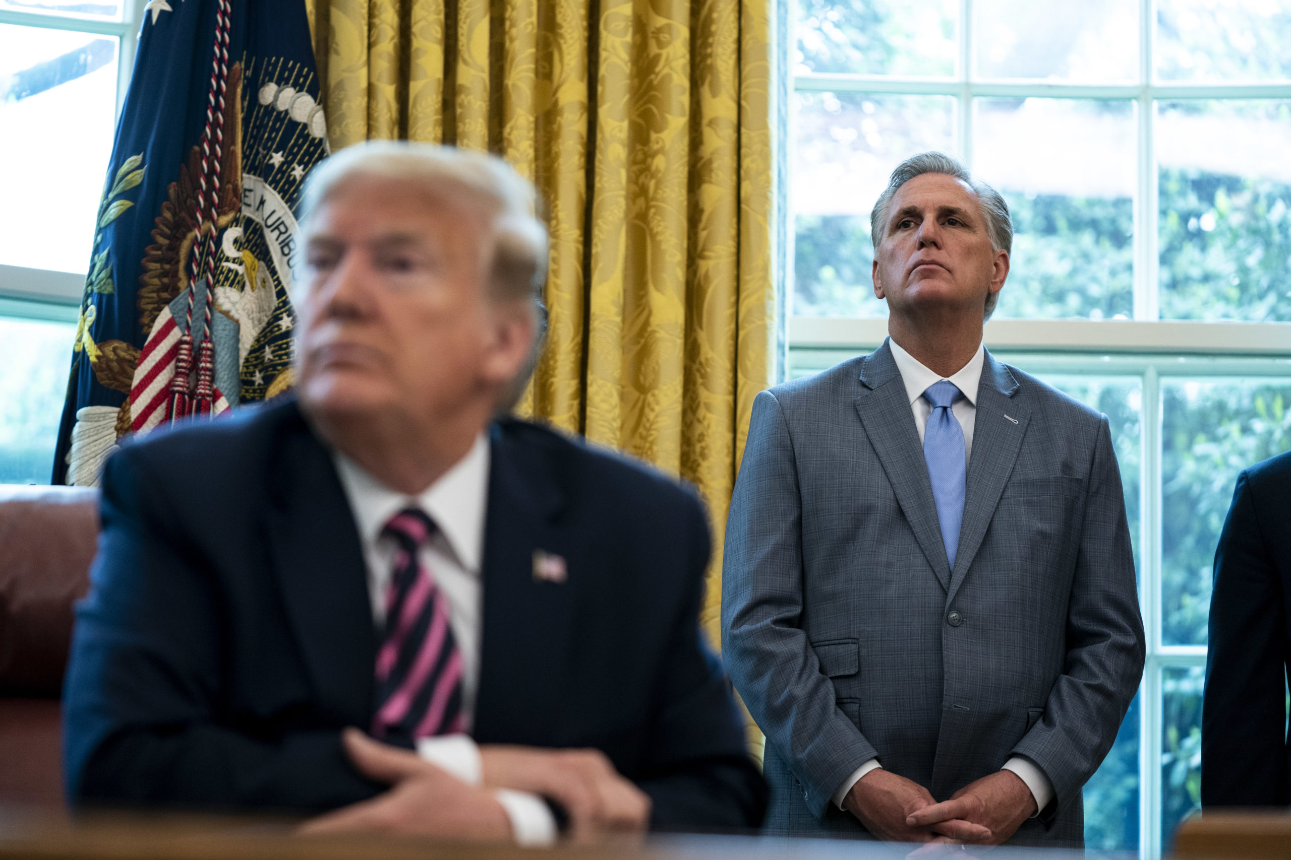 WASHINGTON, DC - APRIL 24: House Minority Leader Rep. Kevin McCarthy (R-CA) and U.S. President Donald Trump attend a signing ceremony for H.R. 266, the Paycheck Protection Program and Health Care Enhancement Act, in the Oval Office of the White House on April 24, 2020 in Washington, DC. The bill includes an additional $321 billion for the Paycheck Protection Programs forgivable loans to cover payroll and other costs for small businesses. Hospitals and other health care providers will receive $75 billion and another $25 billion is allocated for COVID-19 testing. (Photo by Anna Moneymaker/The New York Times/POOL/Getty Images)
