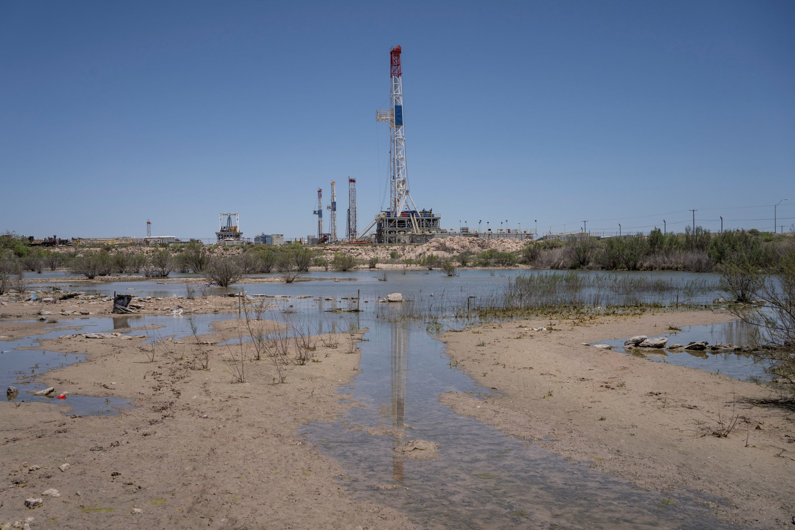 Oil rigs at Double K Drilling are pictured on April 24, 2020 near Odessa, Texas. - Oil and gas is one of the main economic drivers of this area, and the industry has taken a hit after the price of oil dropped below zero earlier this week due to decline in demand from the novel coronavirus pandemic and a price war between Russia and Saudi Arabia. (Photo by Paul Ratje / AFP) (Photo by PAUL RATJE/AFP via Getty Images)