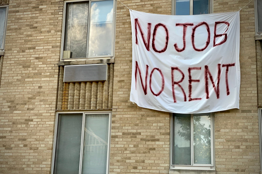A banner against renters eviction is displayed on a controlled rent building in Washington, D.C on Aug. 9. (Eric Baradat/AFP via Getty Images)