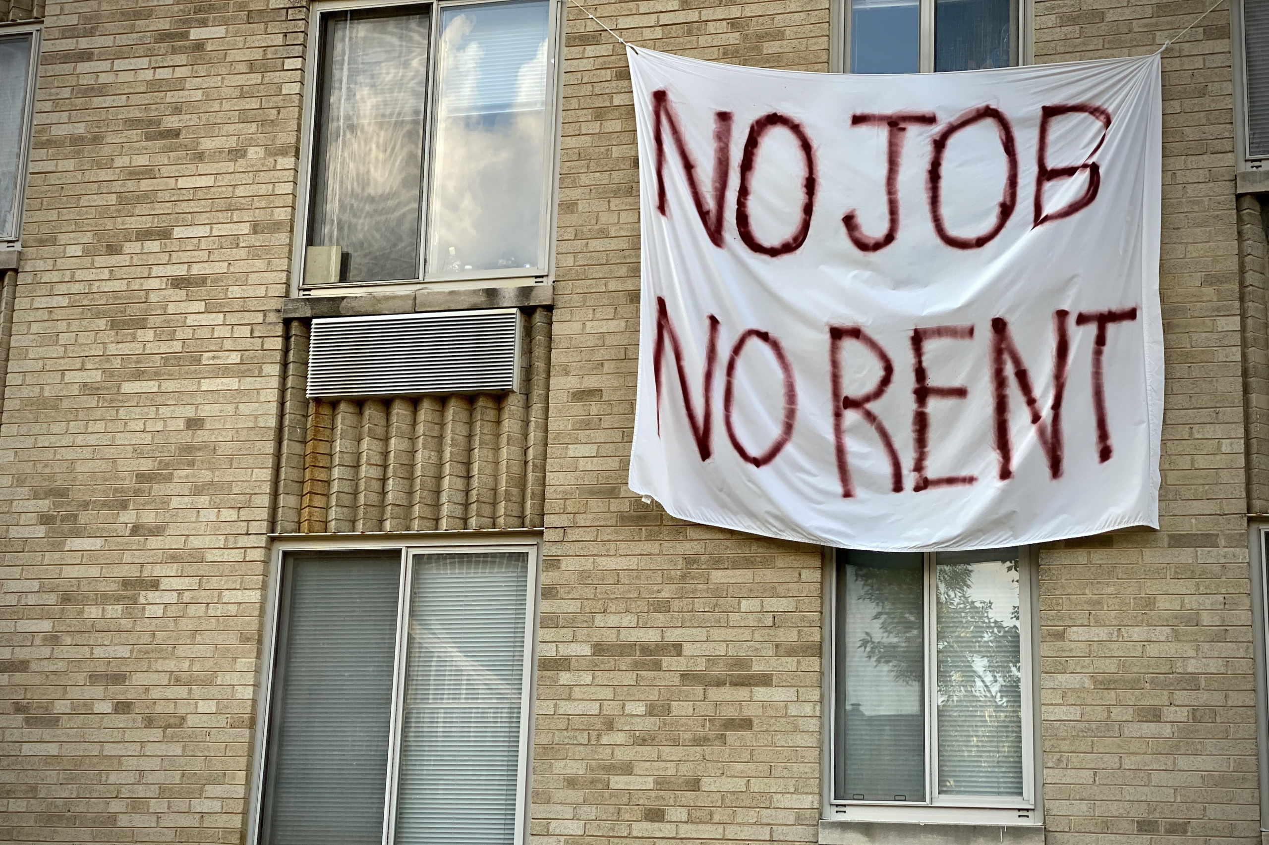 A banner against eviction reading no job, no rent is displayed on a controlled rent building in Washington, D.C. (Eric Baradat/AFP via Getty Images)