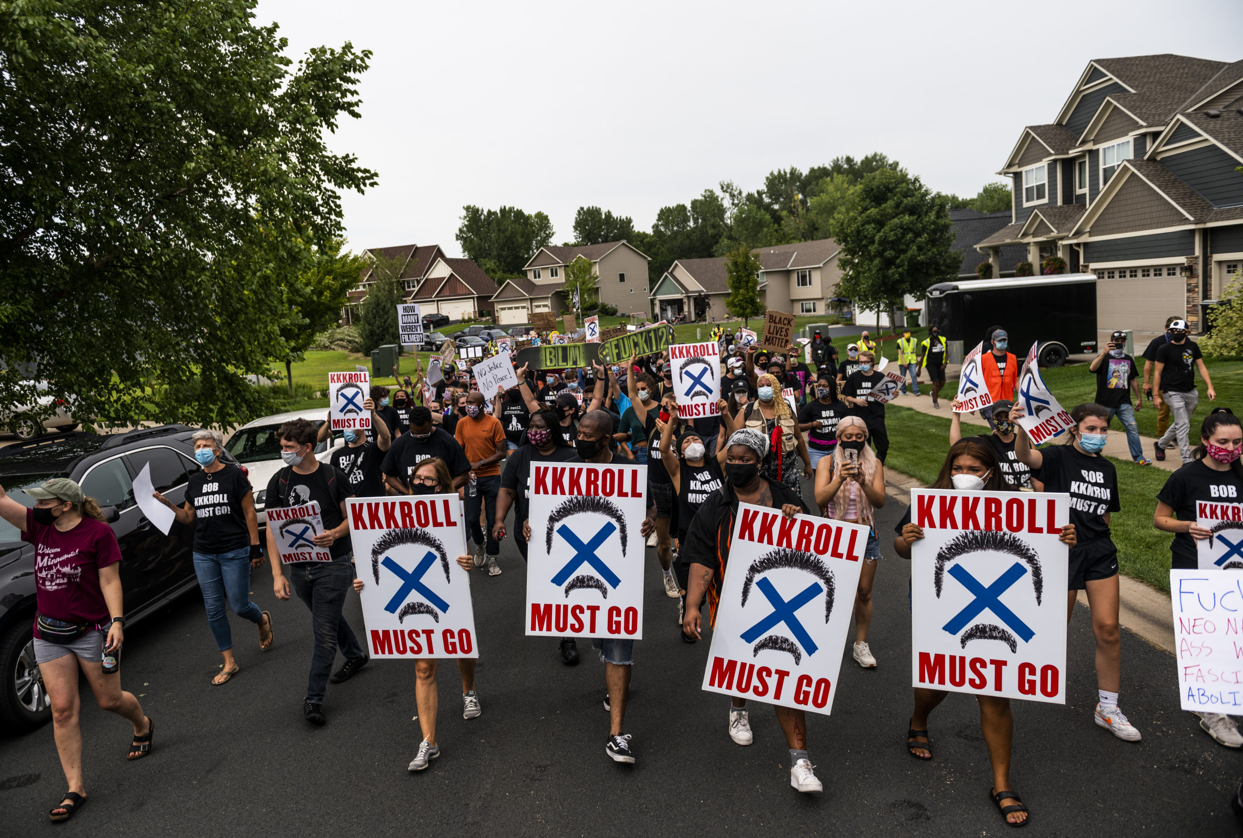 Demonstrators march during a protest near Minneapolis Police Union President Lt. Bob Kroll's house on Aug. 15 in Minnesota. (Stephen Maturen/Getty Images)