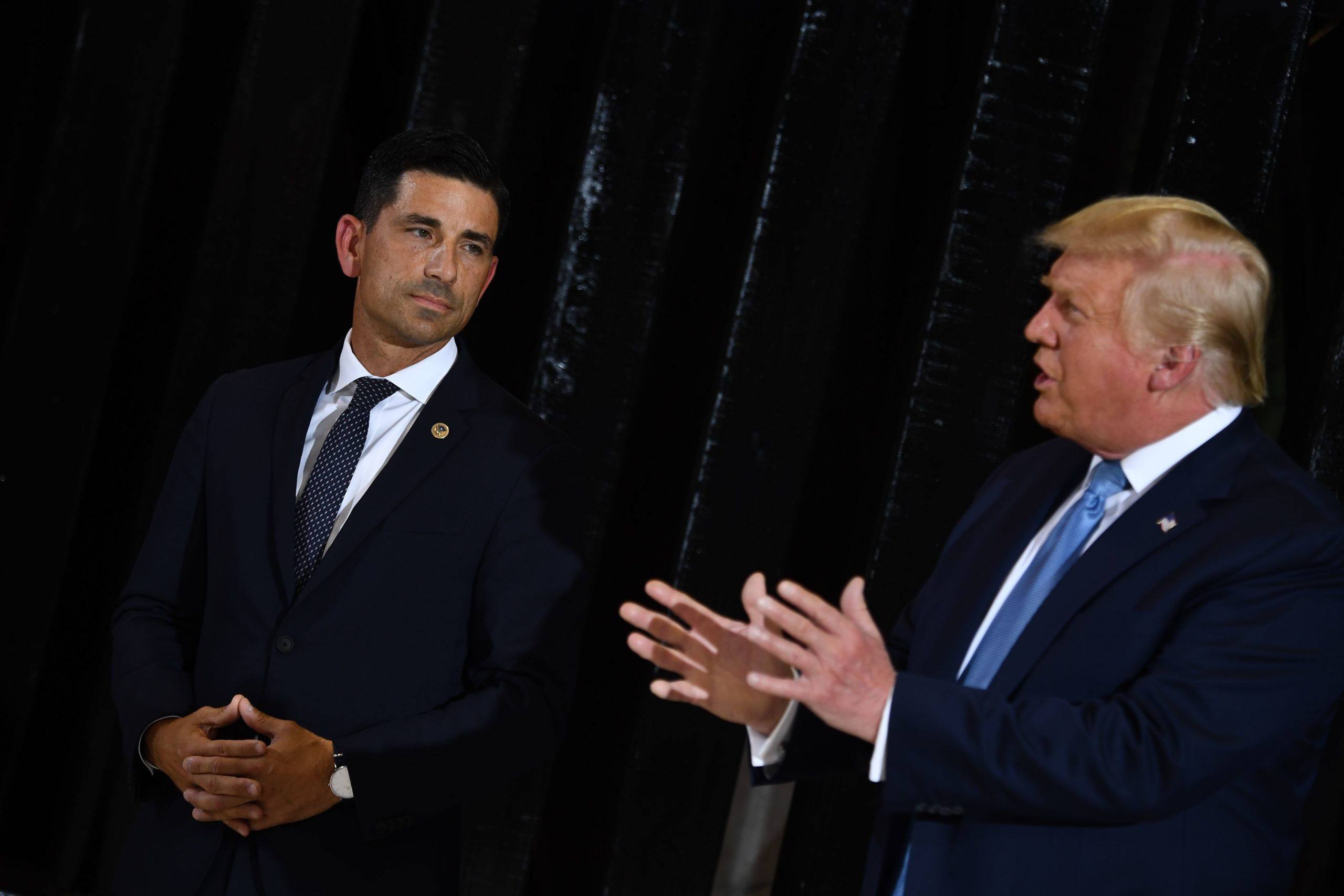 US President Donald Trump delivers remarks on immigration and border security to members of the border patrol as Acting secretary of Homeland Security, Chad Wolf (L) looks on at the international airport in Yuma, Arizona on August 18, 2020. (Photo by BRENDAN SMIALOWSKI/AFP via Getty Images)