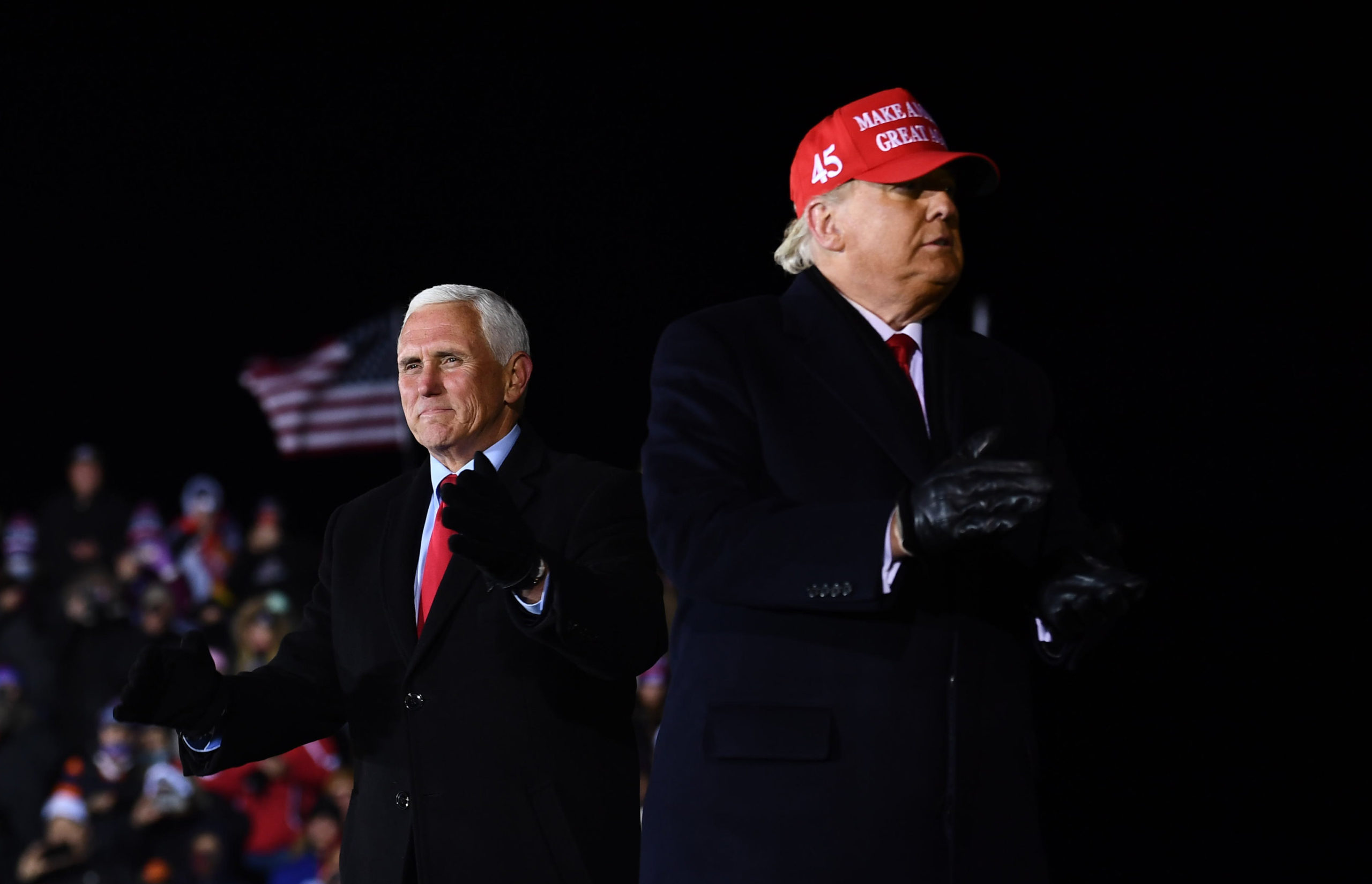 US President Donald Trump stands on stage with Vice President Mike Pence at the conclusion of his final Make America Great Again rally of the 2020 US Presidential campaign at Gerald R. Ford International Airport November 3, 2020, in Grand Rapids, Michigan. (Photo by BRENDAN SMIALOWSKI/AFP via Getty Images)