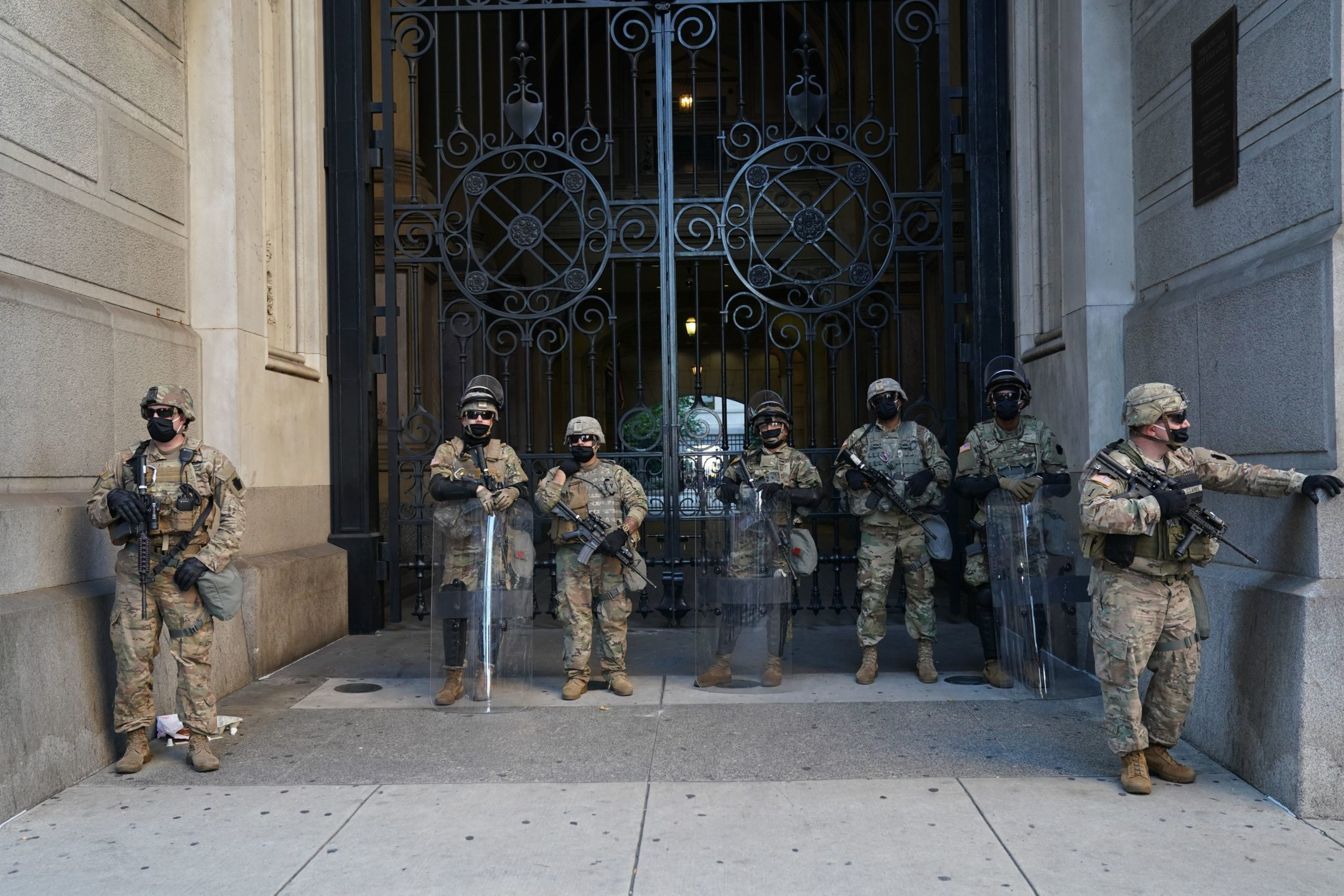 US Army National Guard troops stand outside City Hall after Joe Biden was declared winner of the 2020 presidential election on November 7, 2020 in Philadelphia, Pennsylvania. - Democrat Joe Biden has won the White House, US media said November 7, defeating Donald Trump and ending a presidency that convulsed American politics, shocked the world and left the United States more divided than at any time in decades. (Photo by BRYAN R. SMITH/AFP via Getty Images)