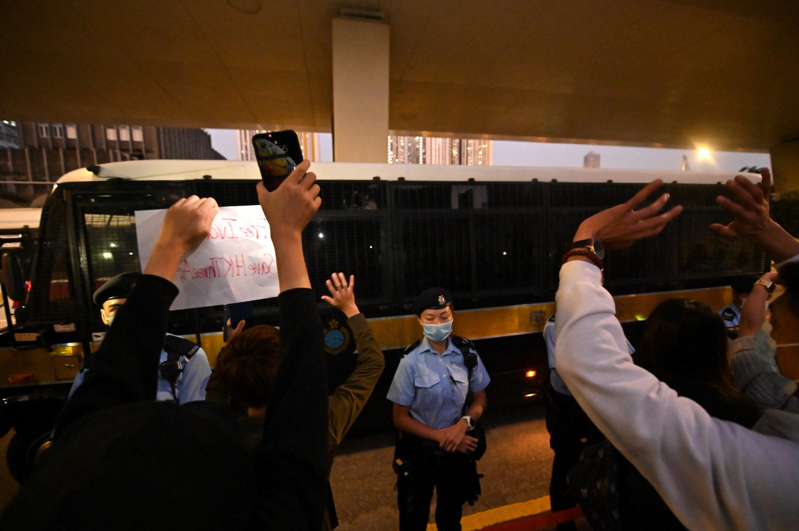 A correctional services bus purportedly carrying pro-democracy activists Agnes Chow, Ivan Lam and Joshua Wong leaves the court in Hong Kong on December 2, 2020, after the three were sentenced after pleading guilty to inciting a rally during pro-democracy protests in 2019, deepening the crackdown against Beijing's critics. (Photo by PETER PARKS/AFP via Getty Images)