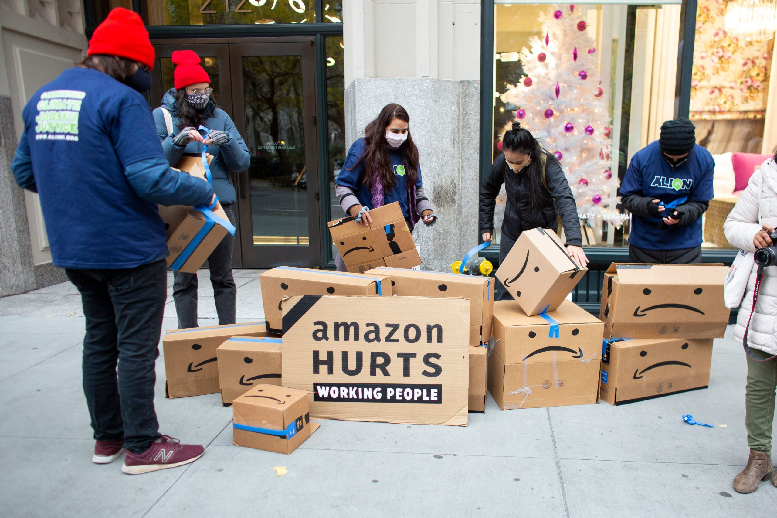 Amazon workers demonstrate during a protest organized by New York Communities for Change in front of the Jeff Bezos' Manhattan residence in New York on Dec. 2. (Kena Betancur/AFP via Getty Images)