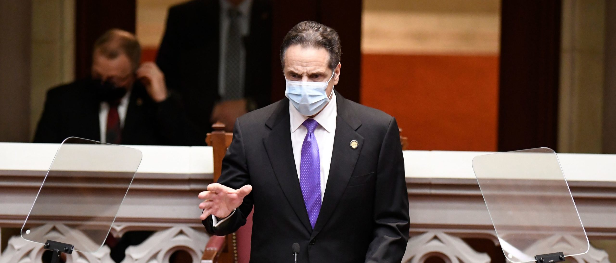 New York Governor Andrew Cuomo speaks to members of New York state's Electoral College before voting for President and Vice President in the Assembly Chamber at the state Capitol in Albany, New York on December 14, 2020. - Joe Biden's march to the White House -- overshadowed by President Donald Trump's frantic attempts to overturn the US election -- is to be formalized when the Electoral College meets to confirm the Democrat's win. (Photo by Hans PENNINK / POOL / AFP) (Photo by HANS PENNINK/POOL/AFP via Getty Images)