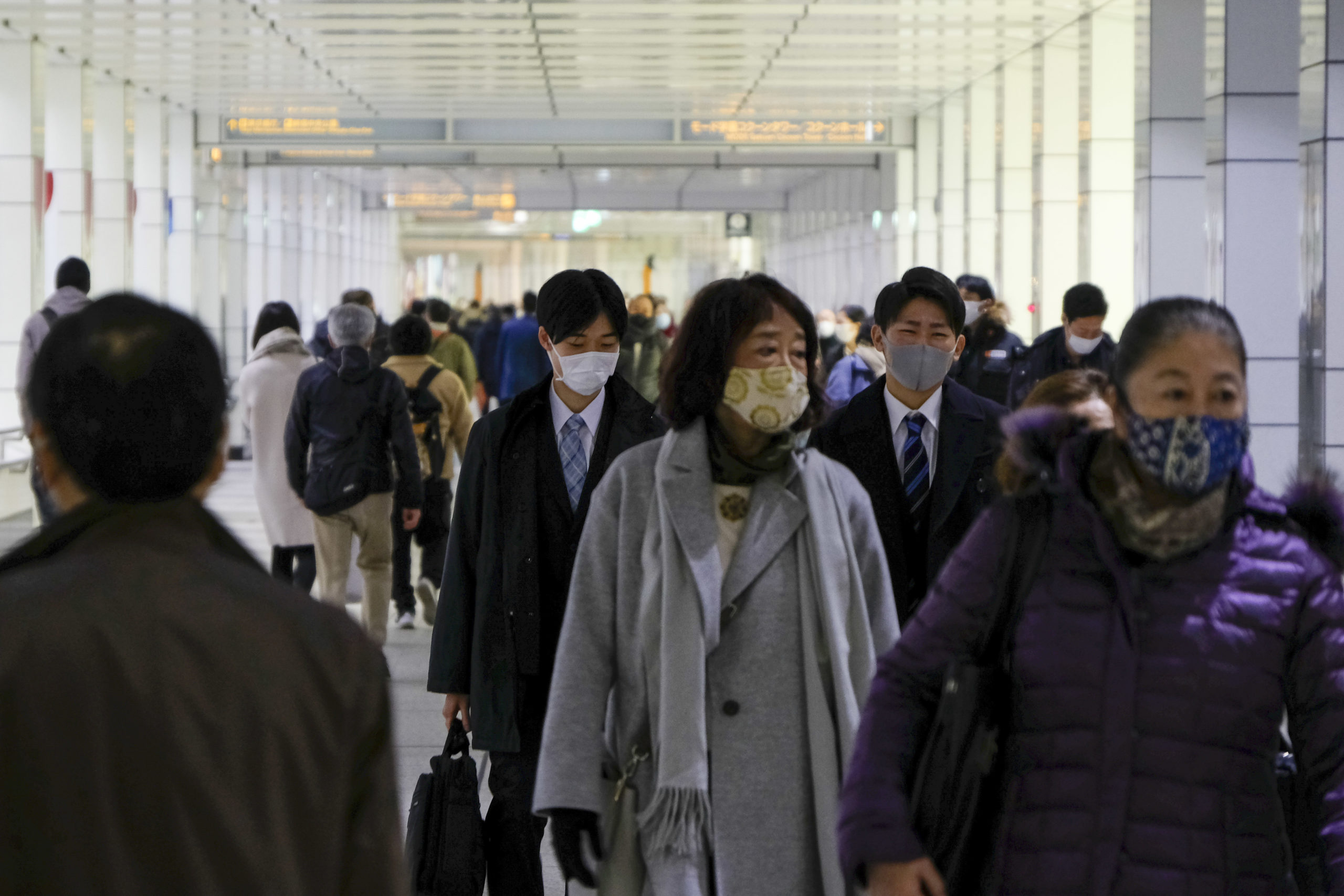 People walk on a concourse leading to the terminal station in Tokyo's Shinjuku district on January 6, 2021, as the city reported 1,591 infections of the Covid-19 coronavirus, a new record high for daily cases. (Photo by Kazuhiro NOGI / AFP) (Photo by KAZUHIRO NOGI/AFP via Getty Images)