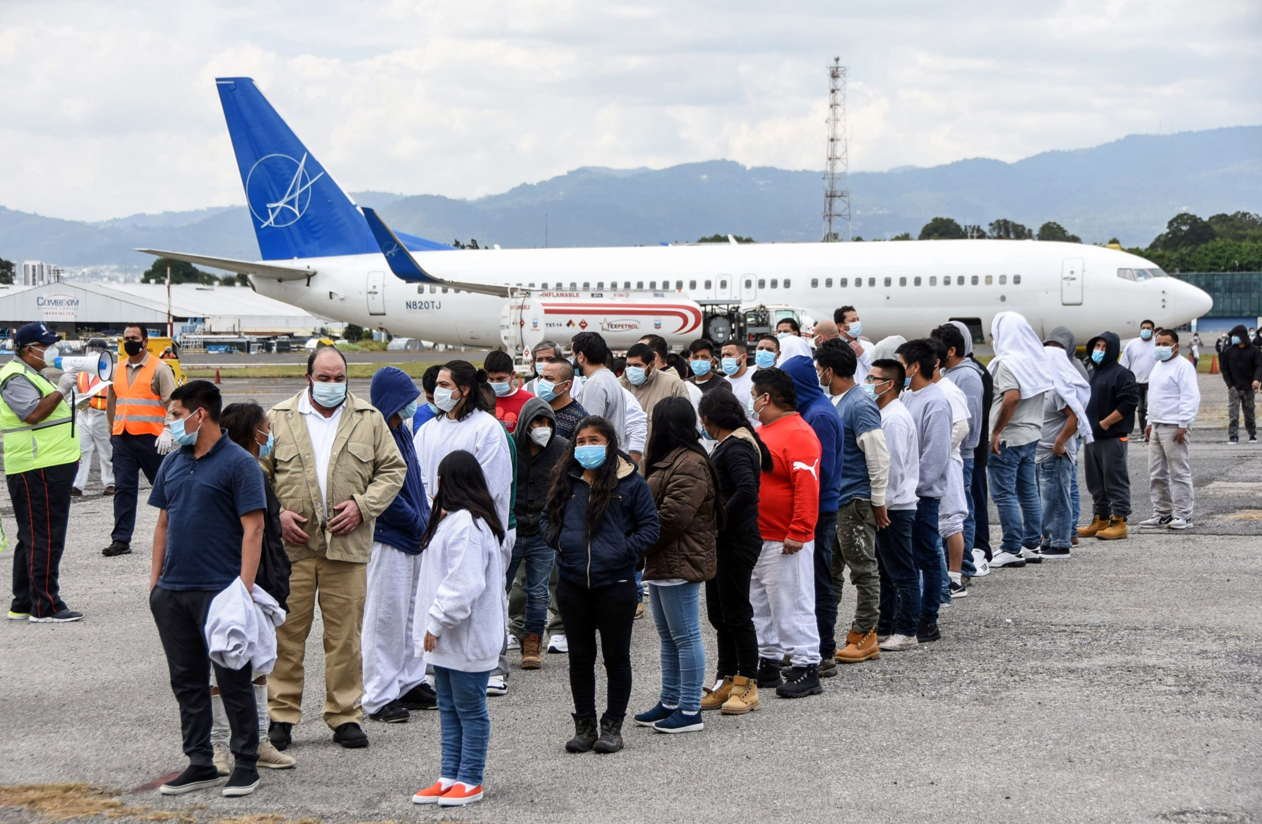 Guatemalan migrants deported from the United States, queue upon their arrival at the Air Force Base in Guatemala City on January 6, 2021. - During 2020, the United States expelled 21.057 Guatemalans by air, a considerably lower number than the 54.599 people deported during 2019, so far the record of deportations, reports Alejandra Mena, spokesman for the Guatemalan State Migration Institute. (Photo by Orlando ESTRADA / AFP) (Photo by ORLANDO ESTRADA/AFP via Getty Images)