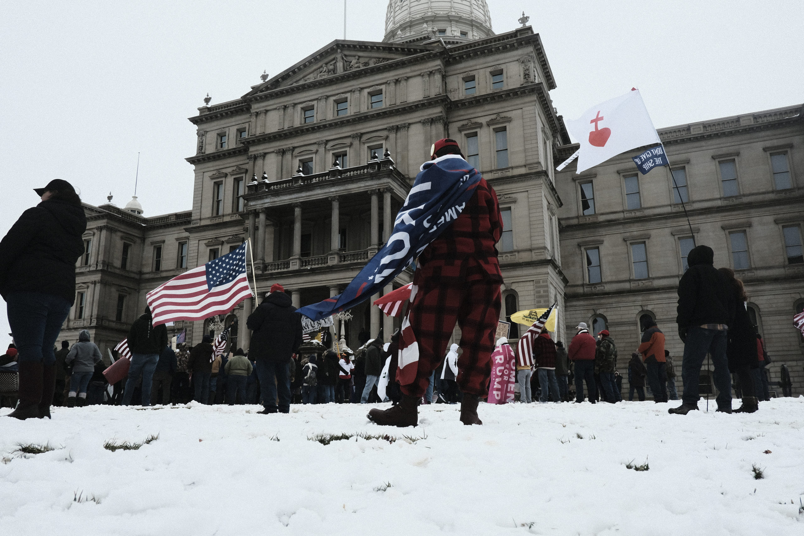 Trump supporters gather around the Michigan State Capitol Building to protest the certification of Joe Biden as the next president of the United States on January 6, 2021 in Lansing, Michigan. (Matthew Hatcher/Getty Images)