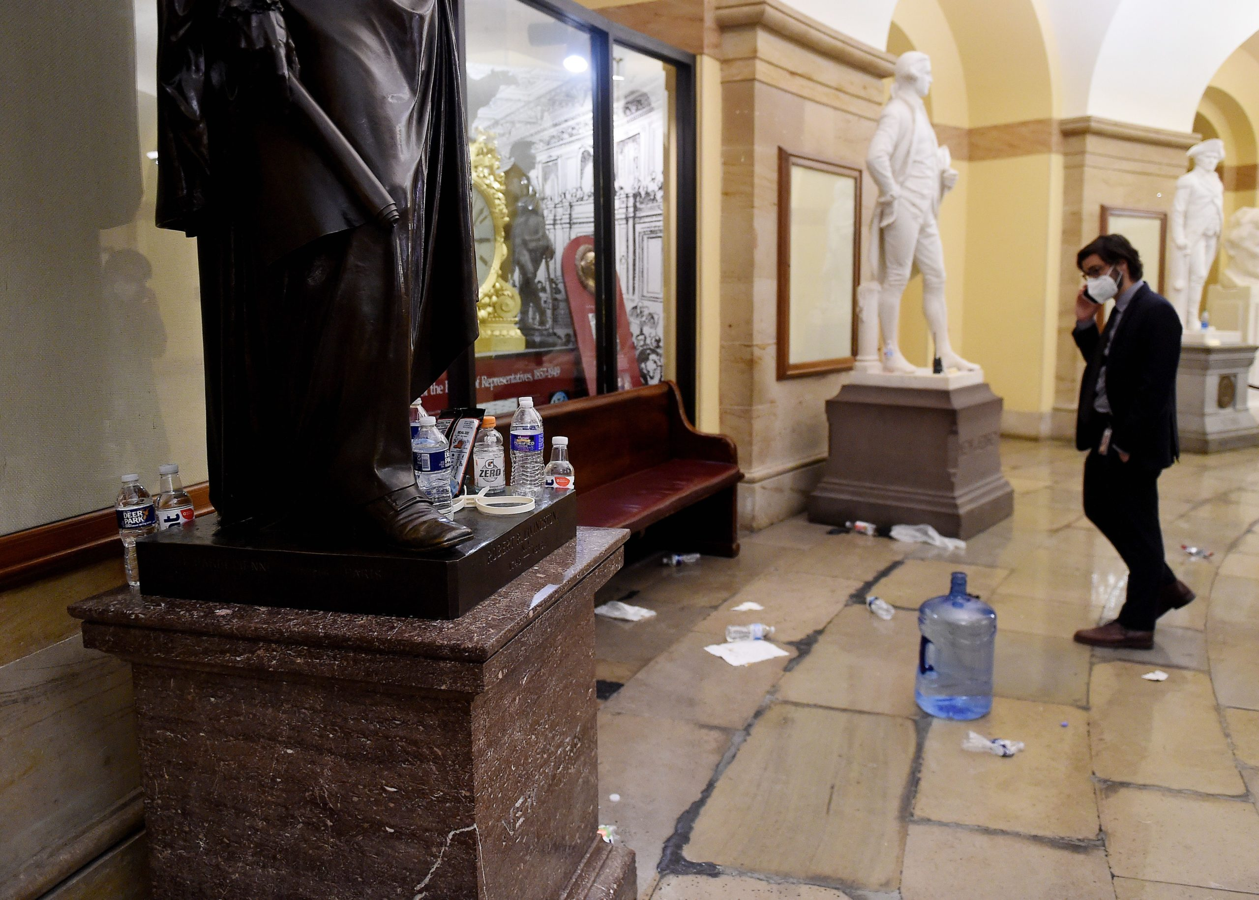 TOPSHOT - Damage is seen inside the US Capitol building early on January 7, 2021 in Washington, DC, after supporters of US President Donald Trump breeched security and entered the building during a session of Congress. - Donald Trump's supporters stormed a session of Congress held today, January 6, to certify Joe Biden's election win, triggering unprecedented chaos and violence at the heart of American democracy and accusations the president was attempting a coup. (Photo by Olivier DOULIERY / AFP) (Photo by OLIVIER DOULIERY/AFP via Getty Images)