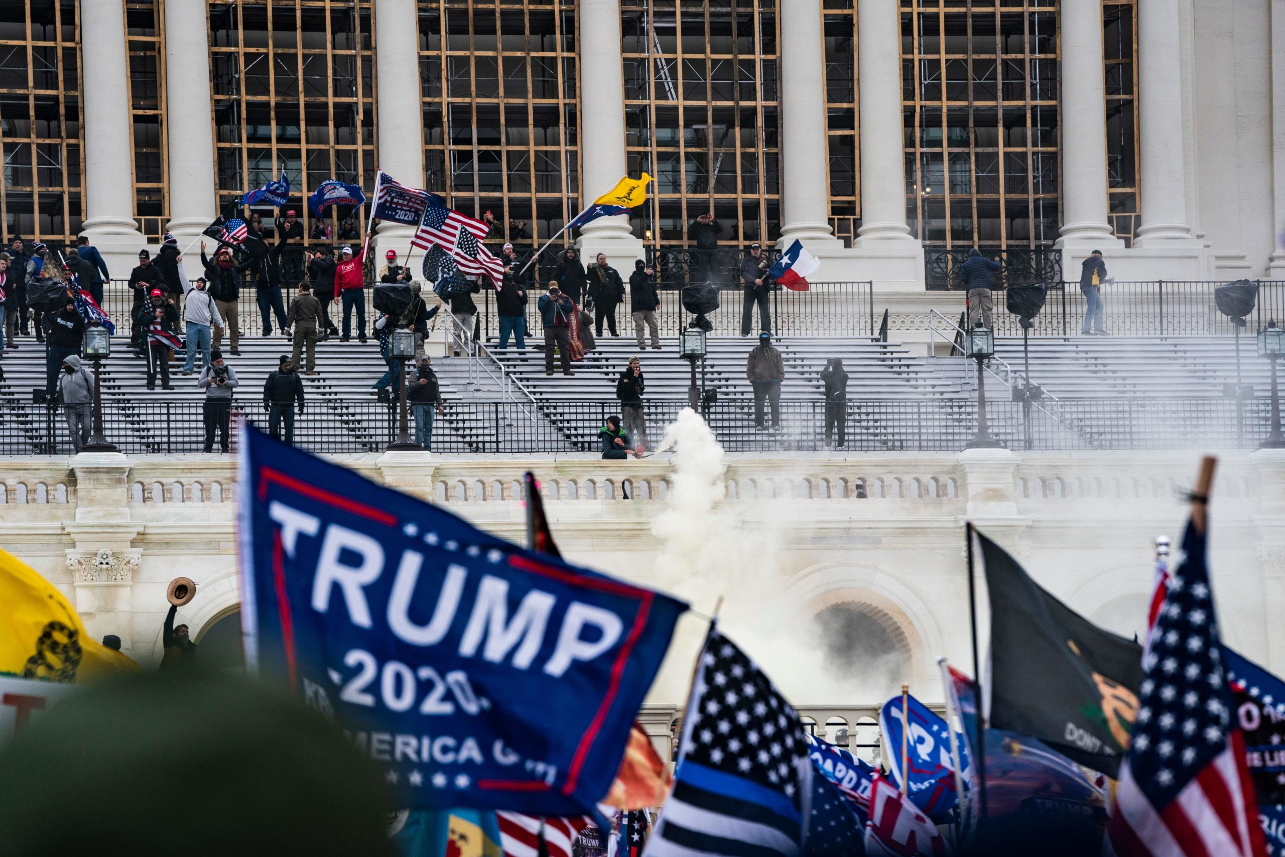 Supporters of US President Donald Trump clash with the US Capitol police during a riot at the US Capitol on January 6, 2021, in Washington, DC. - Donald Trump's supporters stormed a session of Congress held January 6 to certify Joe Biden's election win, triggering unprecedented chaos and violence at the heart of American democracy and accusations the president was attempting a coup. (Photo by ALEX EDELMAN / AFP) (Photo by ALEX EDELMAN/AFP via Getty Images)