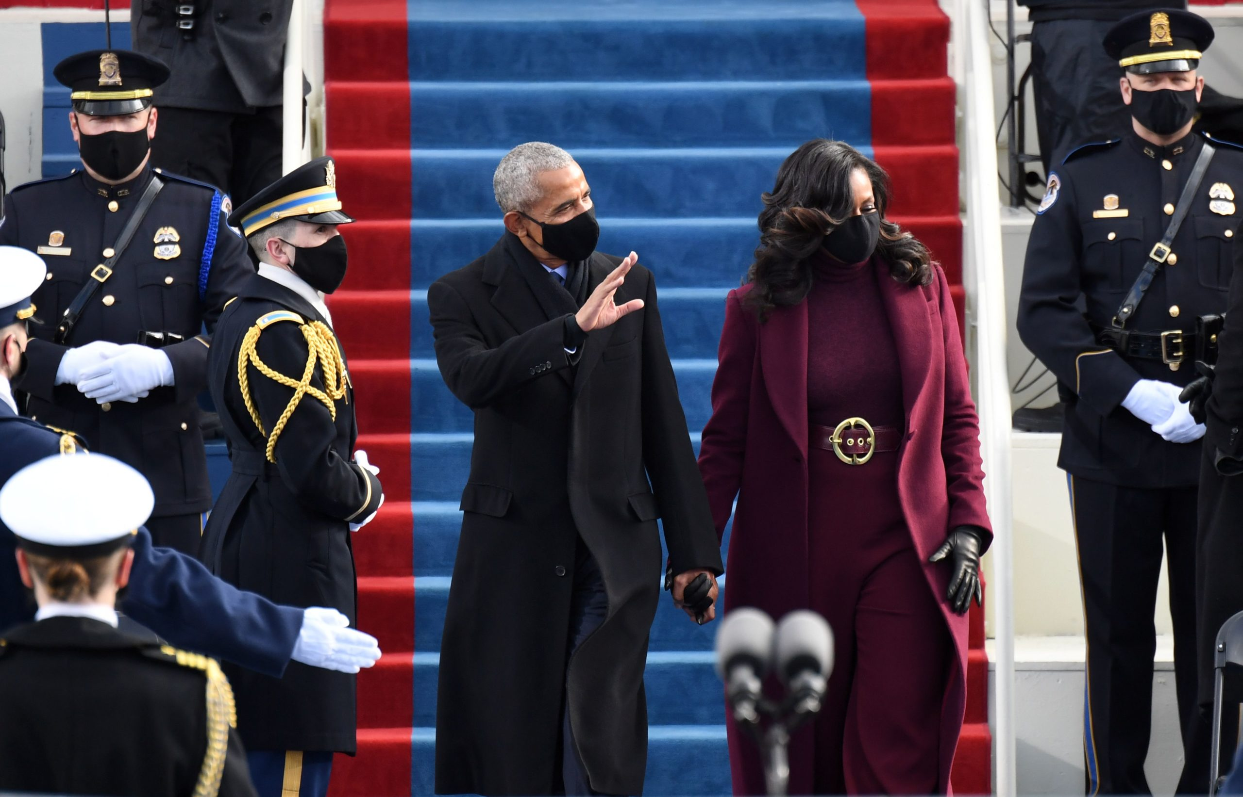 Former US President Barack Obama and former US First Lady Michelle Obama arrive for the inauguration of Joe Biden as the 46th US President on January 20, 2021, at the US Capitol in Washington, DC. (Photo by ANDREW CABALLERO-REYNOLDS / AFP) (Photo by ANDREW CABALLERO-REYNOLDS/AFP via Getty Images)