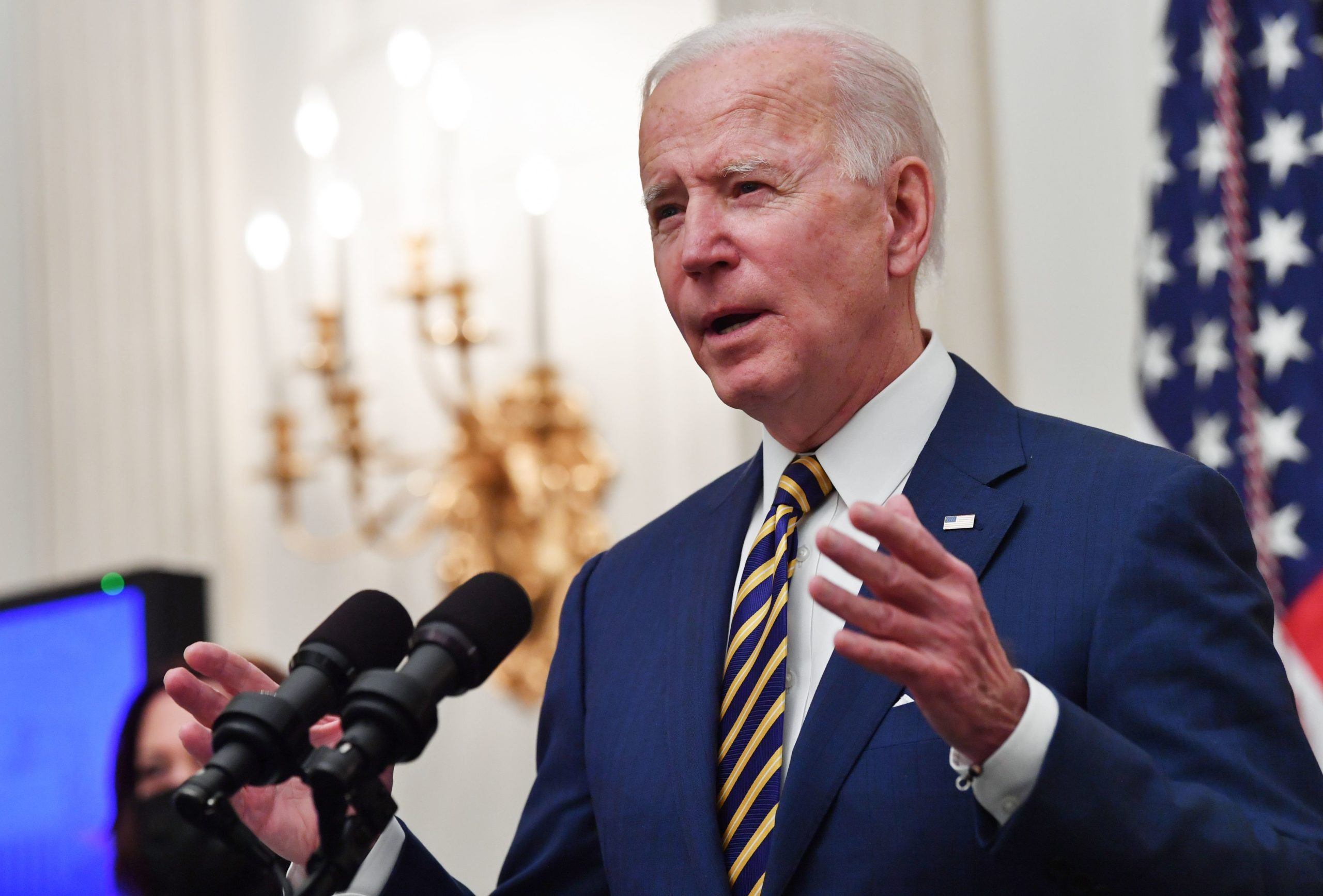 US President Joe Biden speaks about the Covid-19 response before signing executive orders for economic relief to Covid-hit families and businesses in the State Dining Room of the White House in Washington, DC, on January 22, 2021. (Photo by NICHOLAS KAMM/AFP via Getty Images)