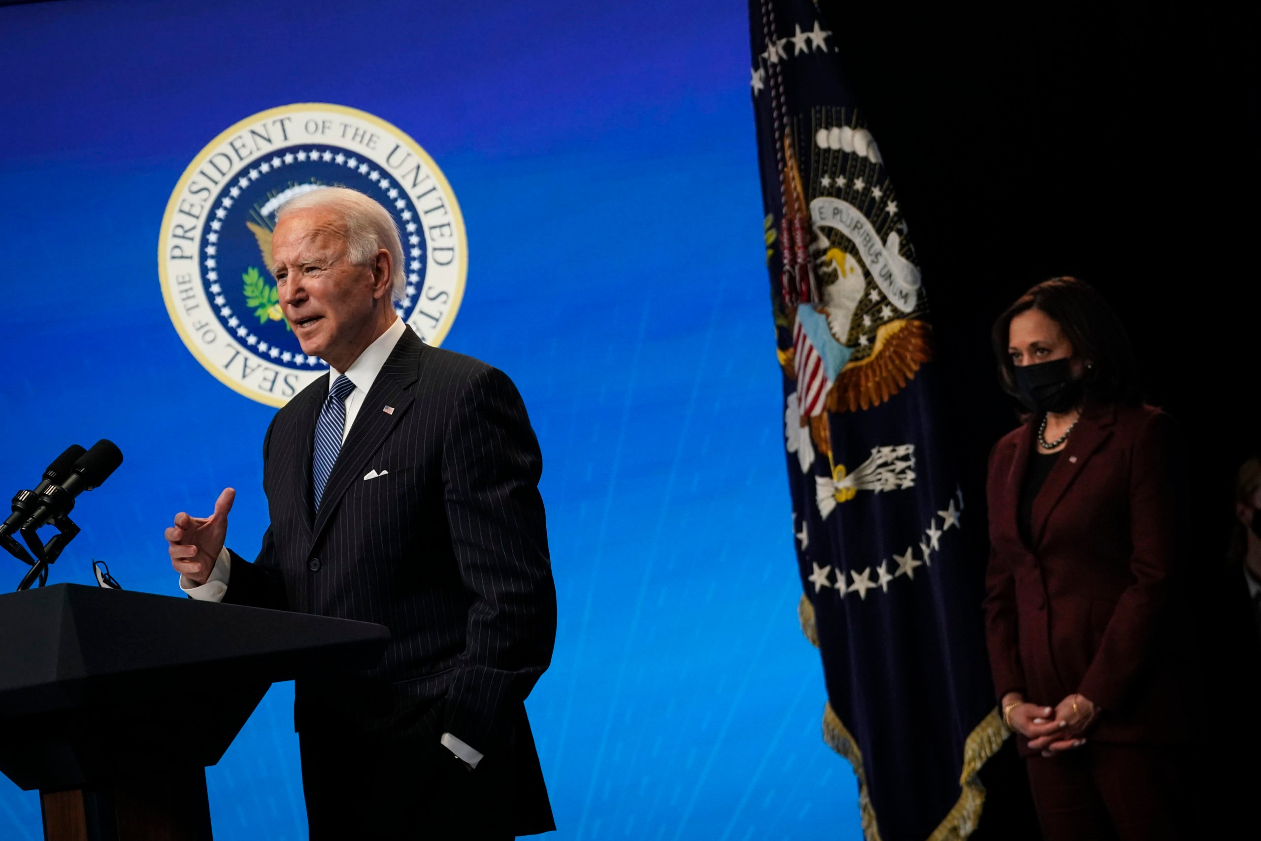 WASHINGTON, DC - JANUARY 25: U.S. Vice President Kamala Harris (R) looks on as U.S. President Joe Biden speaks after signing an executive order related to American manufacturing in the South Court Auditorium of the White House complex on January 25, 2021 in Washington, DC. President Biden signed an executive order aimed at boosting American manufacturing and strengthening the federal government's Buy American rules. (Photo by Drew Angerer/Getty Images)