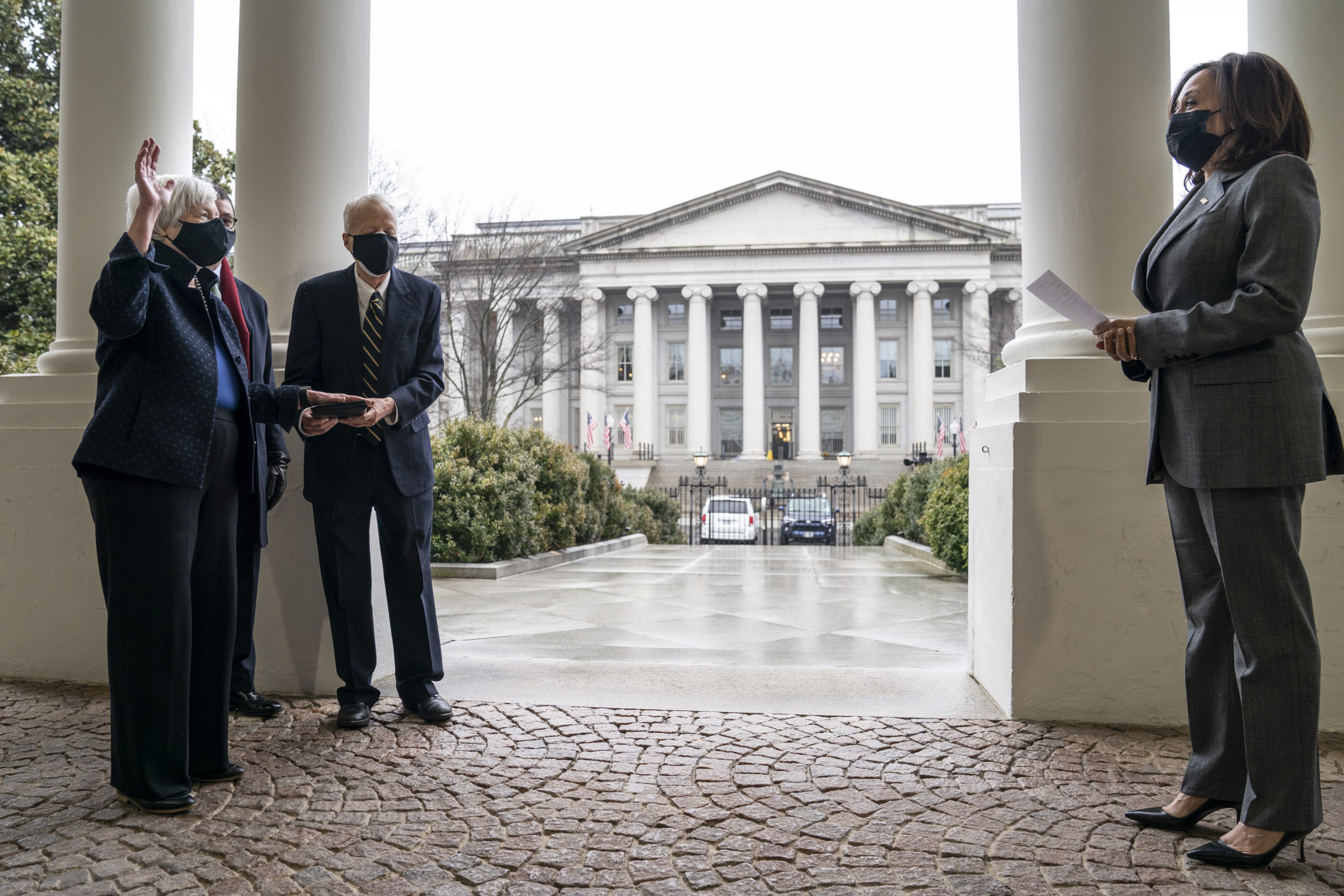 With the Treasury building behind them, Vice President Kamala Harris participates in a ceremonial swearing-in of new Treasury Sec. Janet Yellen on Monday in Washington, D.C. (Drew Angerer/Getty Images)
