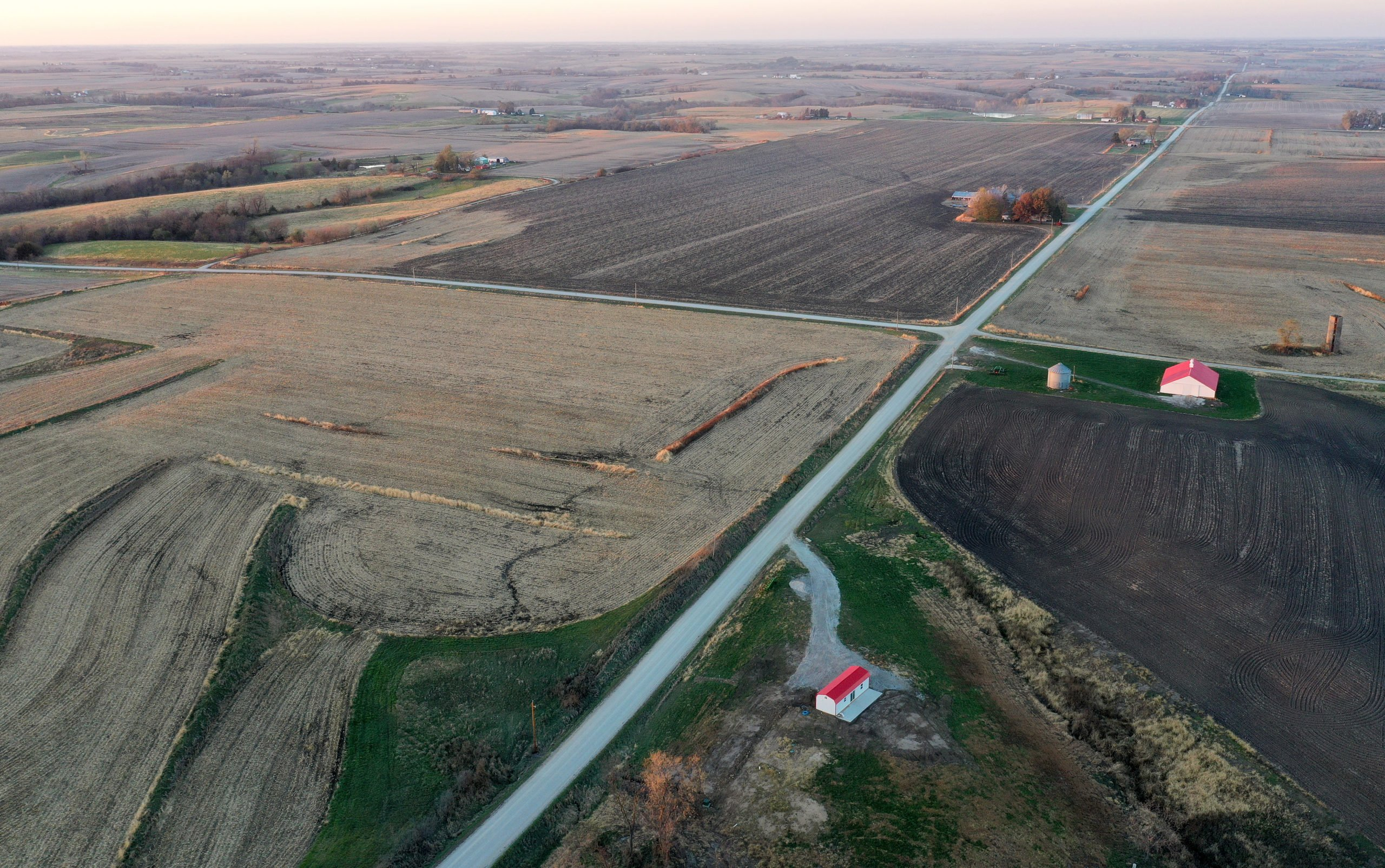 LACONA, IOWA - OCTOBER 30: An aerial view of mostly harvested farmland at sunset in the final days of the 2020 presidential election on October 30, 2020 in Lacona, Iowa. Agriculture remains a vital part of the battleground state's economy. Democratic presidential nominee Joe Biden made a campaign stop in Des Moines today with President Donald Trump scheduled to hold a rally in Dubuque on November 1. (Photo by Mario Tama/Getty Images)