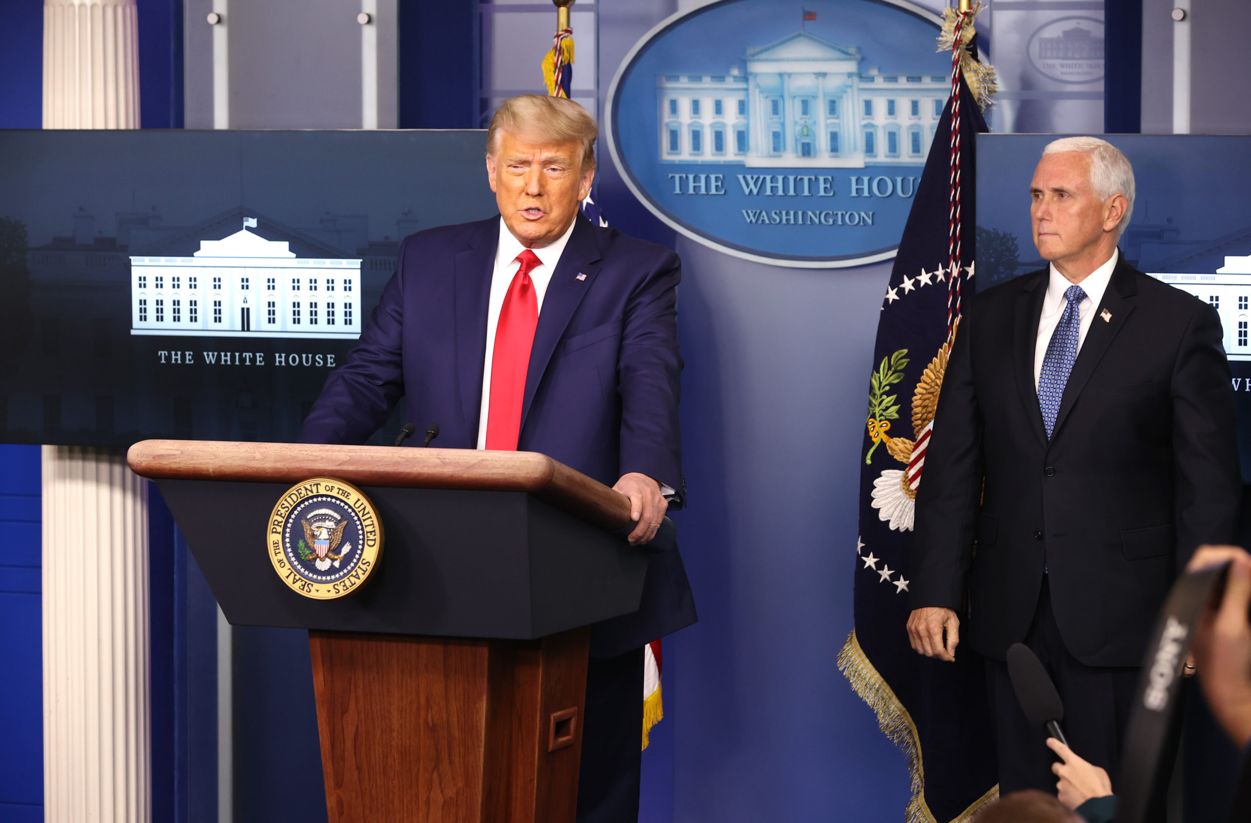 WASHINGTON, DC - NOVEMBER 24: U.S. President Donald Trump (L) speaks as Vice President Mike Pence (R) looks on in the James Brady Press Briefing Room at the White House on November 24, 2020 in Washington, DC. Trump made brief remarks about the stock market hitting 30,000. (Photo by Chip Somodevilla/Getty Images)