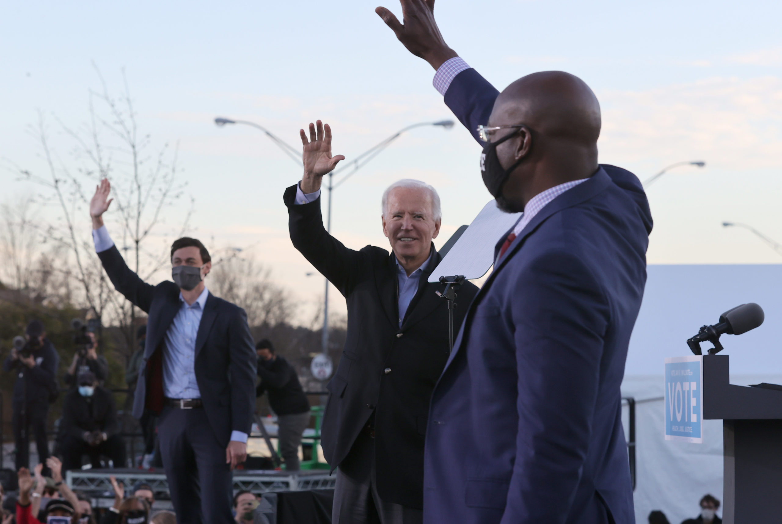 President-elect Joe Biden along with Jon Ossoff and Rev. Raphael Warnock greet supporters during a campaign rally Monday in Atlanta, Georgia. (Chip Somodevilla/Getty Images)