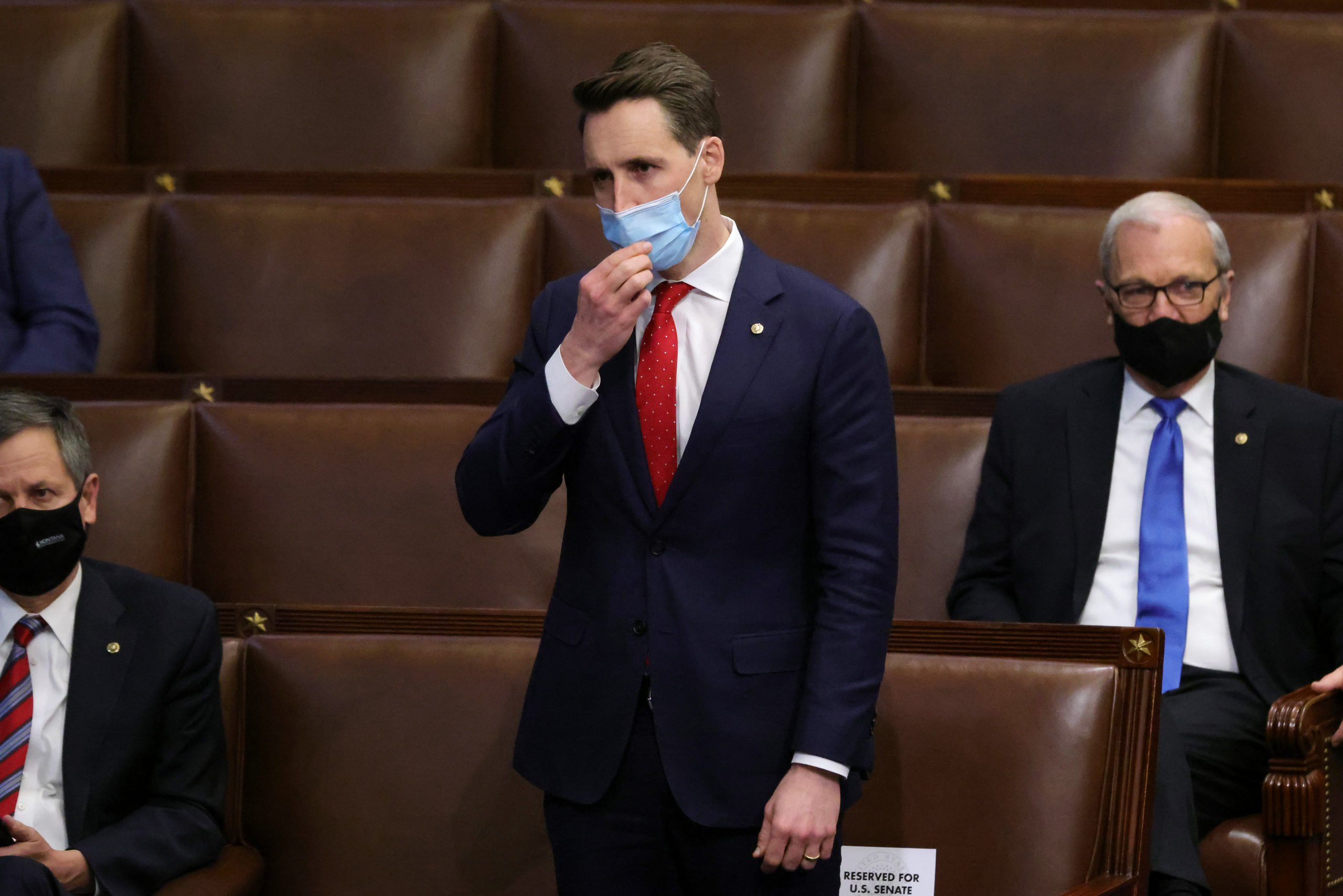 Sen. Josh Hawley (R-MO) signs on to the Pennsylvania objection in the House Chamber during a reconvening of a joint session of Congress on January 06, 2021 in Washington, DC. (Win McNamee/Getty Images)