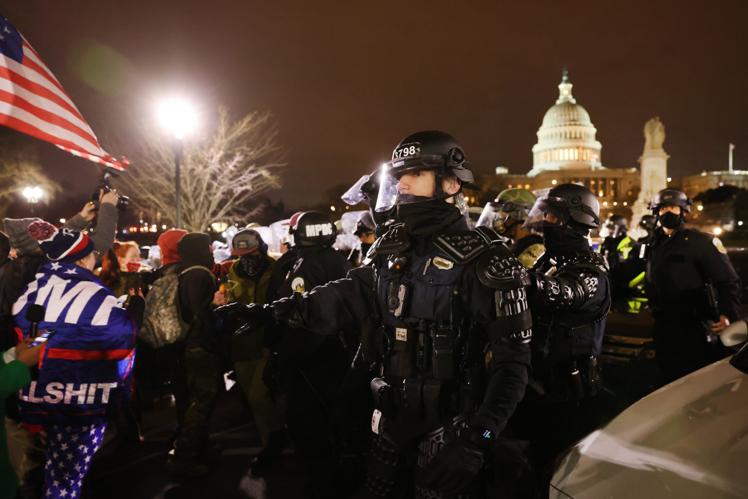 WASHINGTON, DC - JANUARY 06: Members of the National Guard and the Washington D.C. police keep a small group of demonstrators away from the Capital after thousands of Donald Trump supporters stormed the United States Capitol building following a