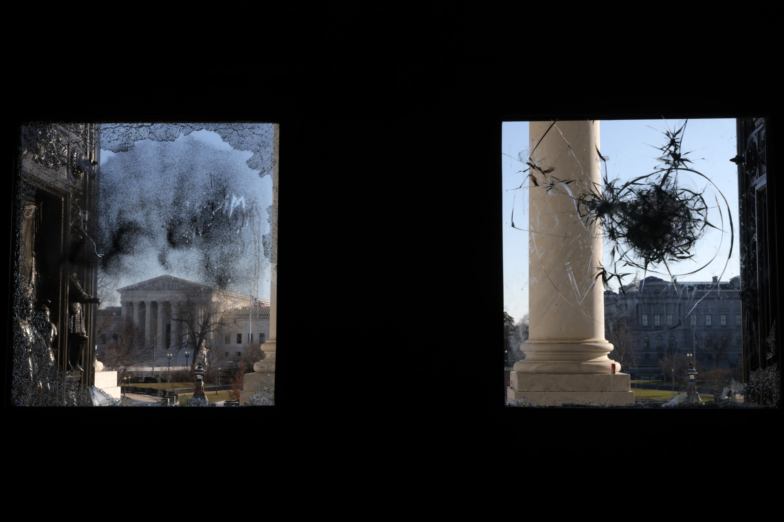 WASHINGTON, DC - JANUARY 07: The U.S. Supreme Court is seen through a damaged entrance of the U.S. Capitol January 7, 2021 in Washington, DC. The U.S. Congress has finished the certification for President-elect Joe Biden and Vice President-elect Kamala Harris' electoral college win after pro-Trump mobs stormed the Capitol and temporarily stopped the process. (Photo by Alex Wong/Getty Images)
