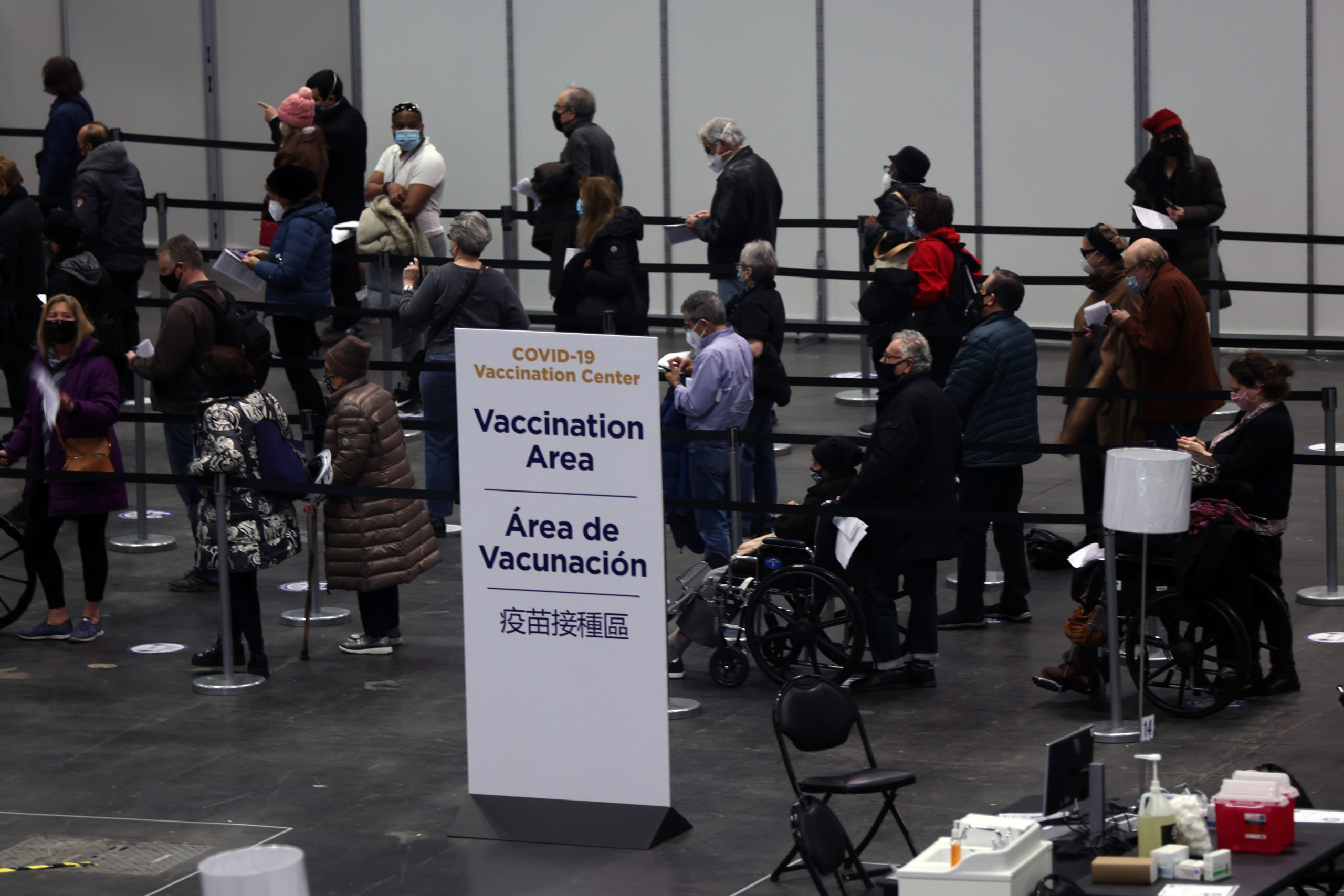 People wait inside New York City's Javits Center which opened as a coronavirus vaccination site on Jan. 13. (Spencer Platt/Getty Images)