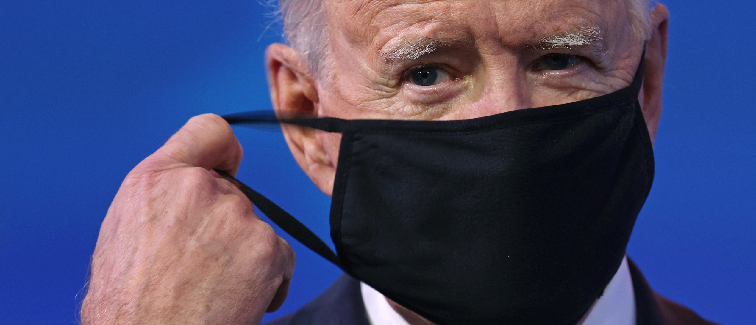 WILMINGTON, DELAWARE - JANUARY 15: U.S. President-elect Joe Biden takes off his mask as he arrives at the Queen theater to lay out his plan on combating the coronavirus January 15, 2021 in Wilmington, Delaware. President-elect Biden is announcing his plan to administer COVID-19 vaccines to Americans. (Photo by Alex Wong/Getty Images)