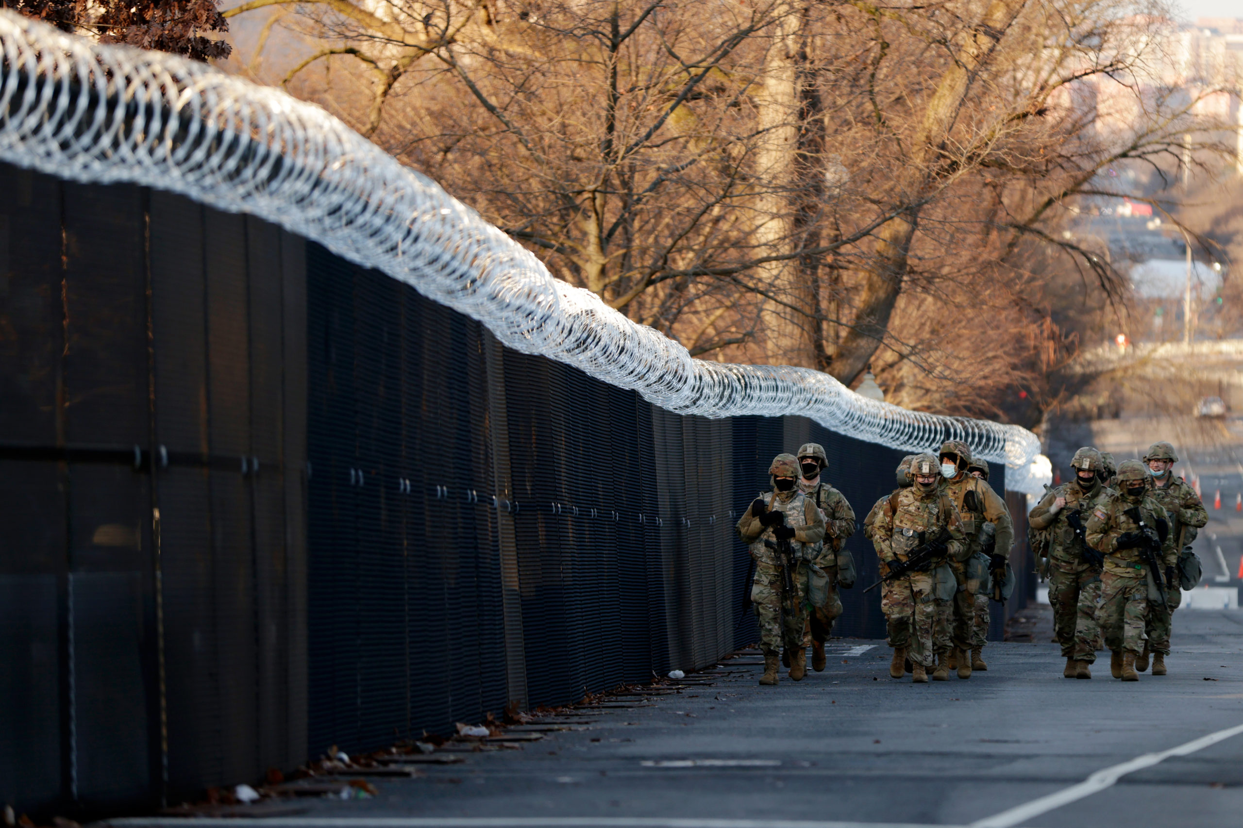 WASHINGTON, DC - JANUARY 16: A group of Virginia National Guard patrol around the razor wire fence surrounding the U.S. Capitol grounds on January 16, 2021 in Washington, DC. After last week's riots at the U.S. Capitol Building, the FBI has warned of additional threats in the nation's capital and in all 50 states. According to reports, as many as 25,000 National Guard soldiers will be guarding the city as preparations are made for the inauguration of Joe Biden as the 46th U.S. President. (Photo by Samuel Corum/Getty Images)