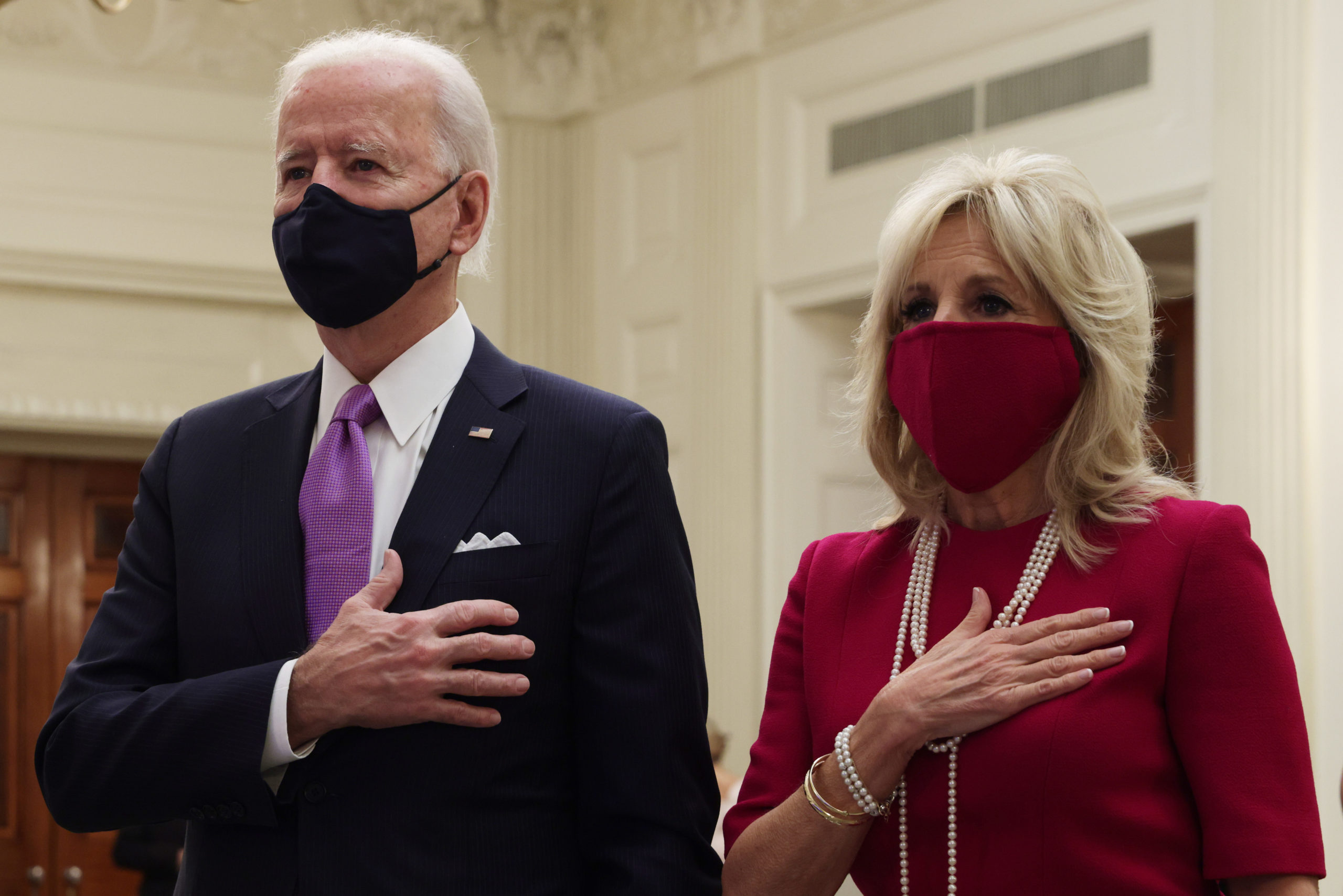WASHINGTON, DC - JANUARY 21: U.S. President Joe Biden (L) and first lady Dr. Jill Biden listen to the national anthem as they watch the virtual presidential inaugural prayer service in the State Dining Room of the White House January 21, 2021 in Washington, DC. The prayer service, a tradition which dates back to the first inauguration of U.S. President George Washington, went virtual this year due to the COVID-19 pandemic. (Photo by Alex Wong/Getty Images)