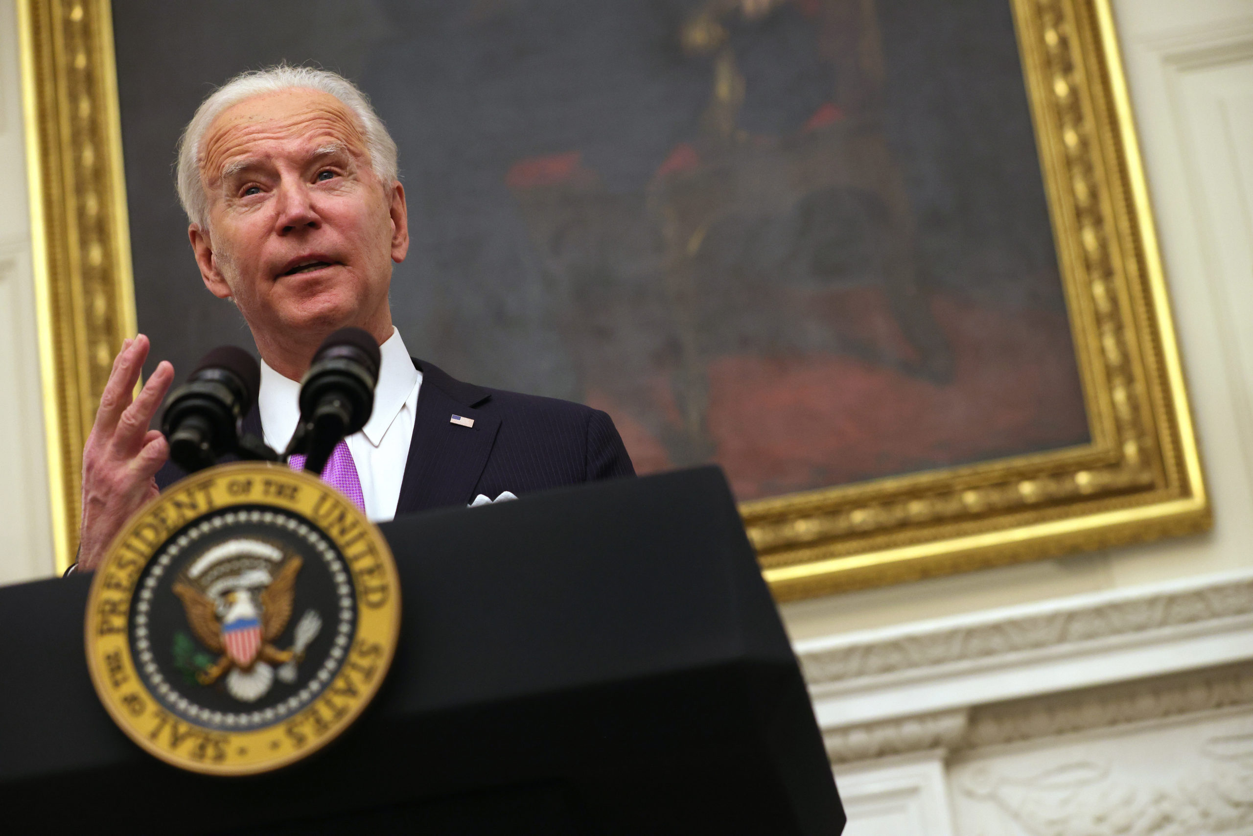 WASHINGTON, DC - JANUARY 21: U.S. President Joe Biden speaks during an event in the State Dining Room of the White House January 21, 2021 in Washington, DC. President Biden delivered remarks on his administration's COVID-19 response, and signed executive orders and other presidential actions. (Photo by Alex Wong/Getty Images)