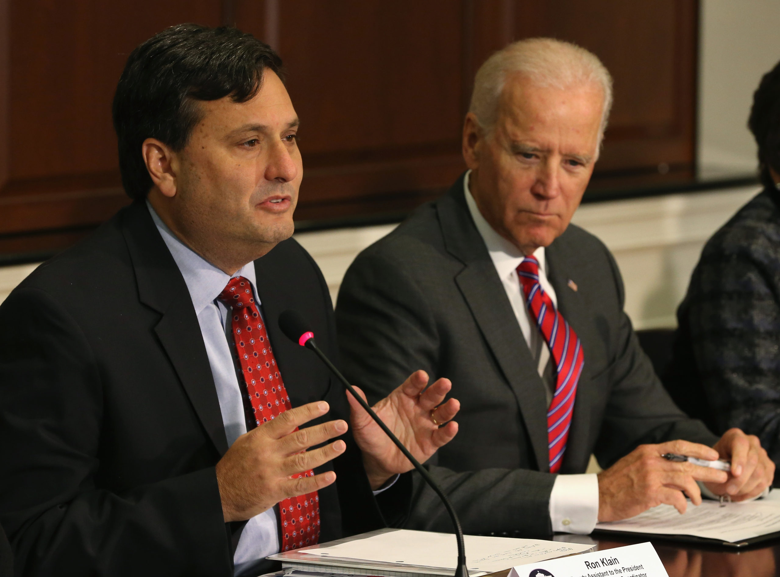 WASHINGTON, DC - NOVEMBER 13: Ebola Response Coordinator Ron Klain (L), joined by U.S. Vice President Joseph Biden (R), speaks during a meeting regarding Ebola at the Eisenhower Executive office building November 13, 2014 in Washington, D.C. Vice President Biden met with leaders of faith, humanitarian, and non-governmental organizations that are responding to the Ebola crisis in West Africa. (Photo by Mark Wilson/Getty Images)