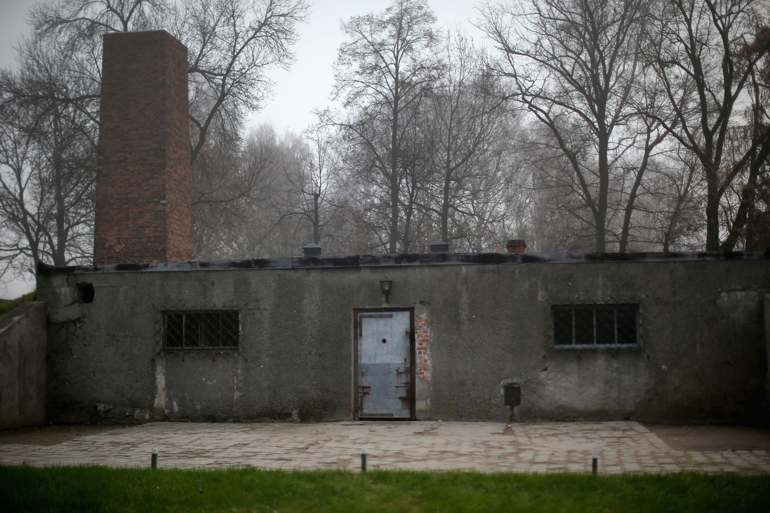 OSWIECIM, POLAND - NOVEMBER 15: The door is closed to the crematorium and gas chamber building at the Auschwitz I extermination camp on November 15, 2014 in Oswiecim, Poland. Ceremonies marking the 70th anniversary of the liberation of the camp by Soviet soldiers are due to take place on January 27, 2015. Auschwitz was a network of concentration camps built and operated in occupied Poland by Nazi Germany during the Second World War. Auschwitz I and nearby Auschwitz II-Birkenau was the extermination camp where an estimated 1.1 million people, mostly Jews from across Europe, were killed in gas chambers or from systematic starvation, forced labour, disease and medical experiments. (Photo by Christopher Furlong/Getty Images)