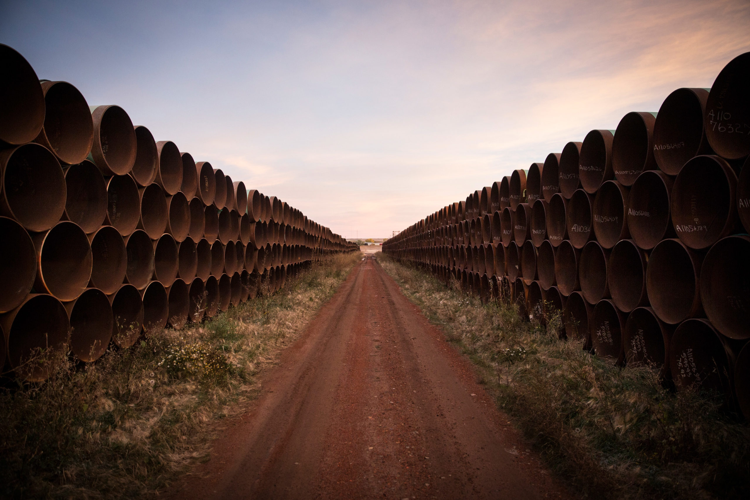 Miles of unused pipe, prepared for the proposed Keystone XL pipeline, sit in a lot on Oct. 14, 2014 outside Gascoyne, North Dakota. (Andrew Burton/Getty Images)