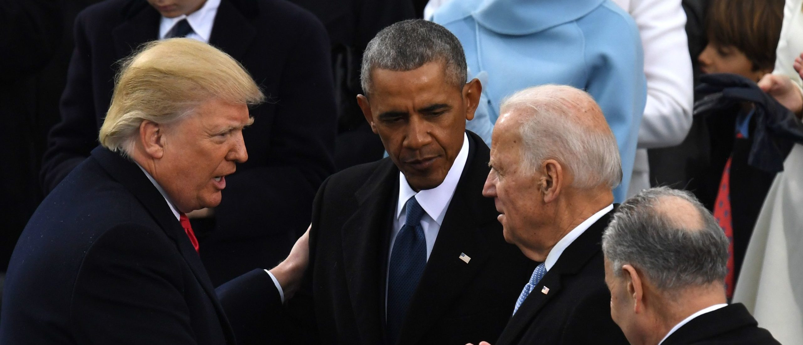 US President Donald Trump (L) shakes hands with former US President Barack Obama (C) and former vice-President Joe Biden after being sworn in as President on January 20, 2017 at the US Capitol in Washington, DC. (MARK RALSTON/AFP via Getty Images)