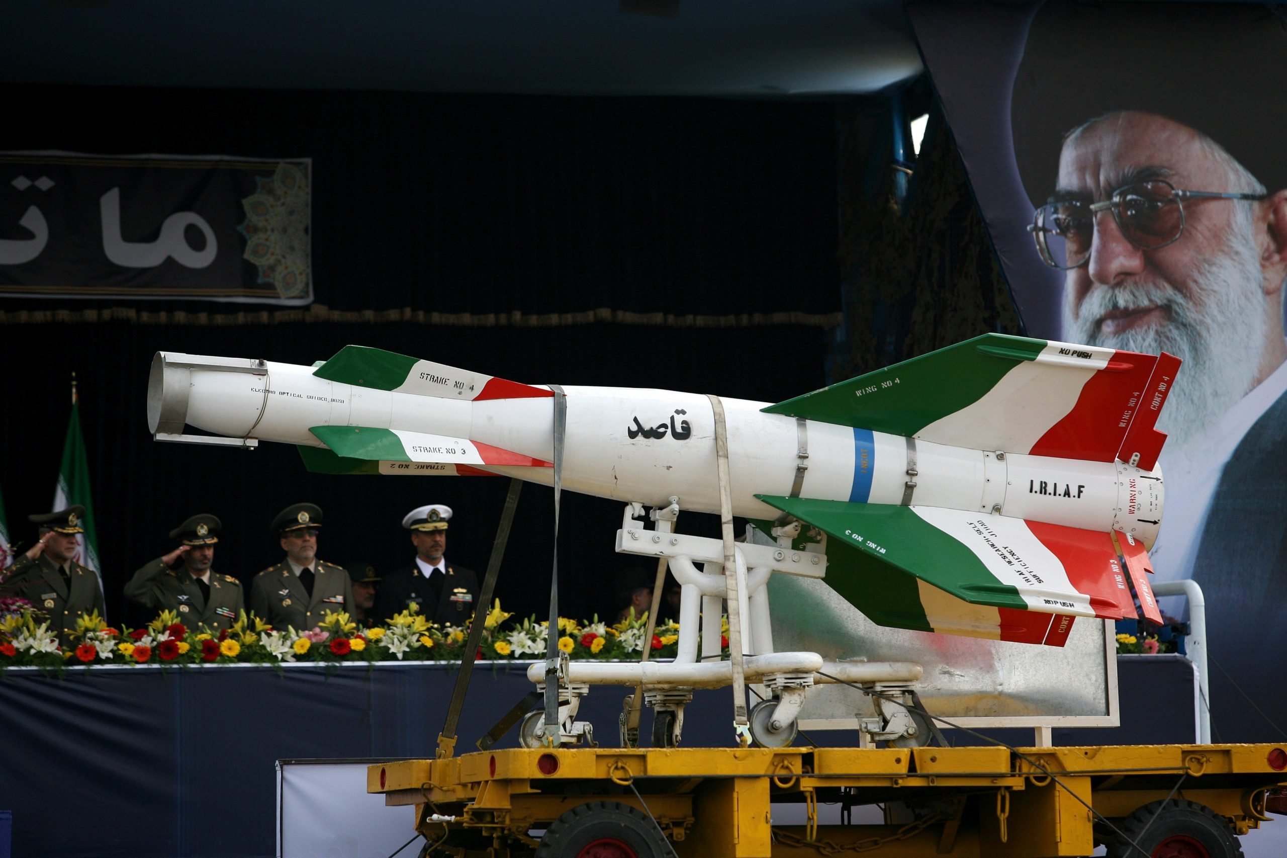 """TEHRAN, IRAN - APRIL 17: An Iranian surface to surface Ghasedak missile is driven past portraits of Iran's late founder of the Islamic Republic, Ayatollah Ali khamenei (R), during the annual army day military parade on April 17, 2008 in Tehran, Iran. Ahmadinejad proclaimed today the country's army was a powerful deterrent to all enemies saying """"No major power is able to jeopardize the Iranian nation's security and interests due to the Iranian people's power today, Iran's army, the Revolutionary Guards and the Basij would respond strongly to even the minimum aggression,"""" (Photo by Majid/Getty Images)"""