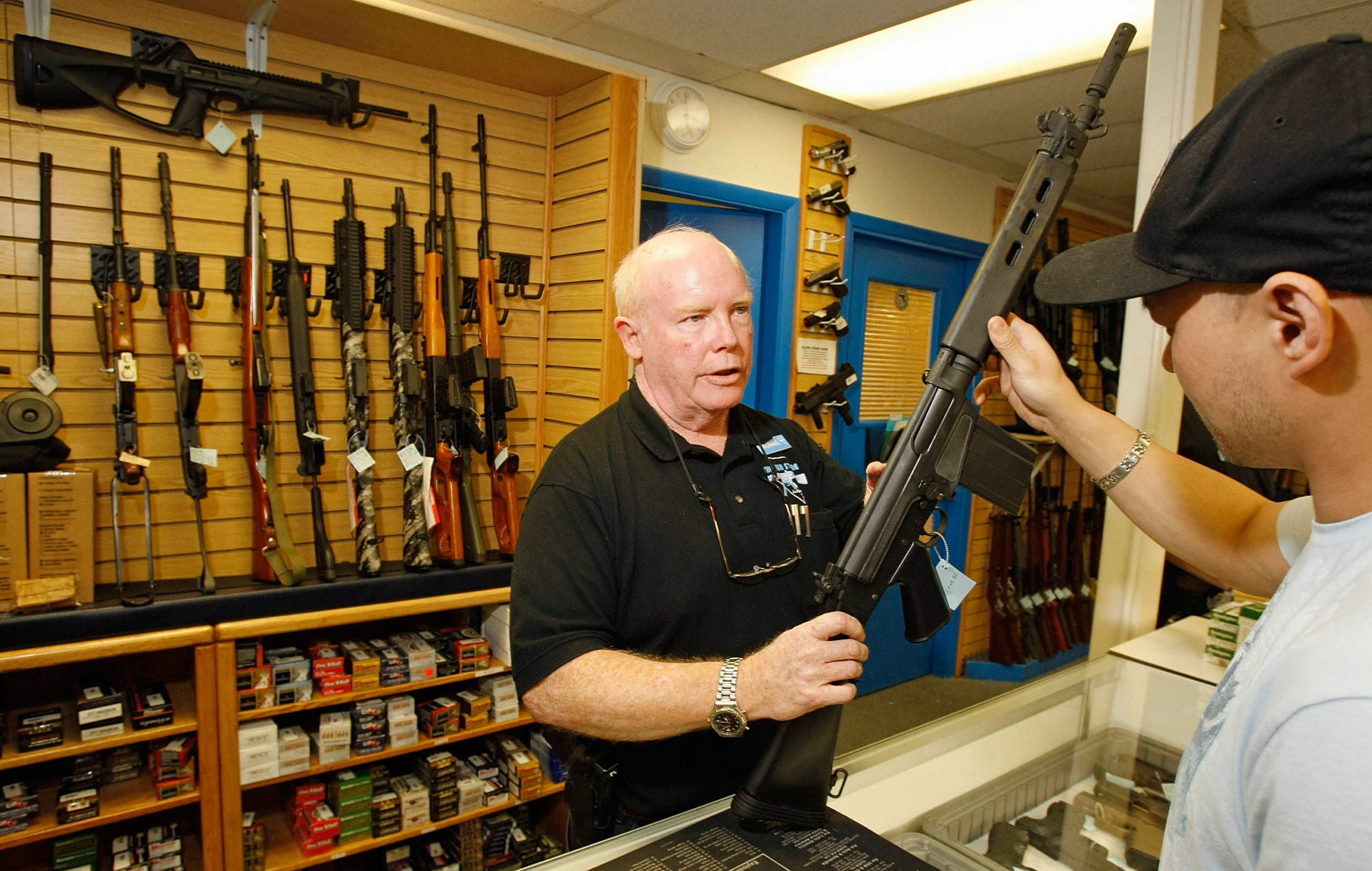 LAS VEGAS - NOVEMBER 14: The Gun Store sales associate Michael Rogers (L) shows Won Kim of Nevada a rifle November 14, 2008 in Las Vegas, Nevada. Store manager Cliff Wilson said he's seen a large spike in sales since Barack Obama was elected president on November 4, with customers citing fears about the president-elect's record on firearms. The election, combined with a slumping economy, has contributed to an overall increase of 25-30 percent in gun sales at the store, Wilson said. (Ethan Miller/Getty Images)