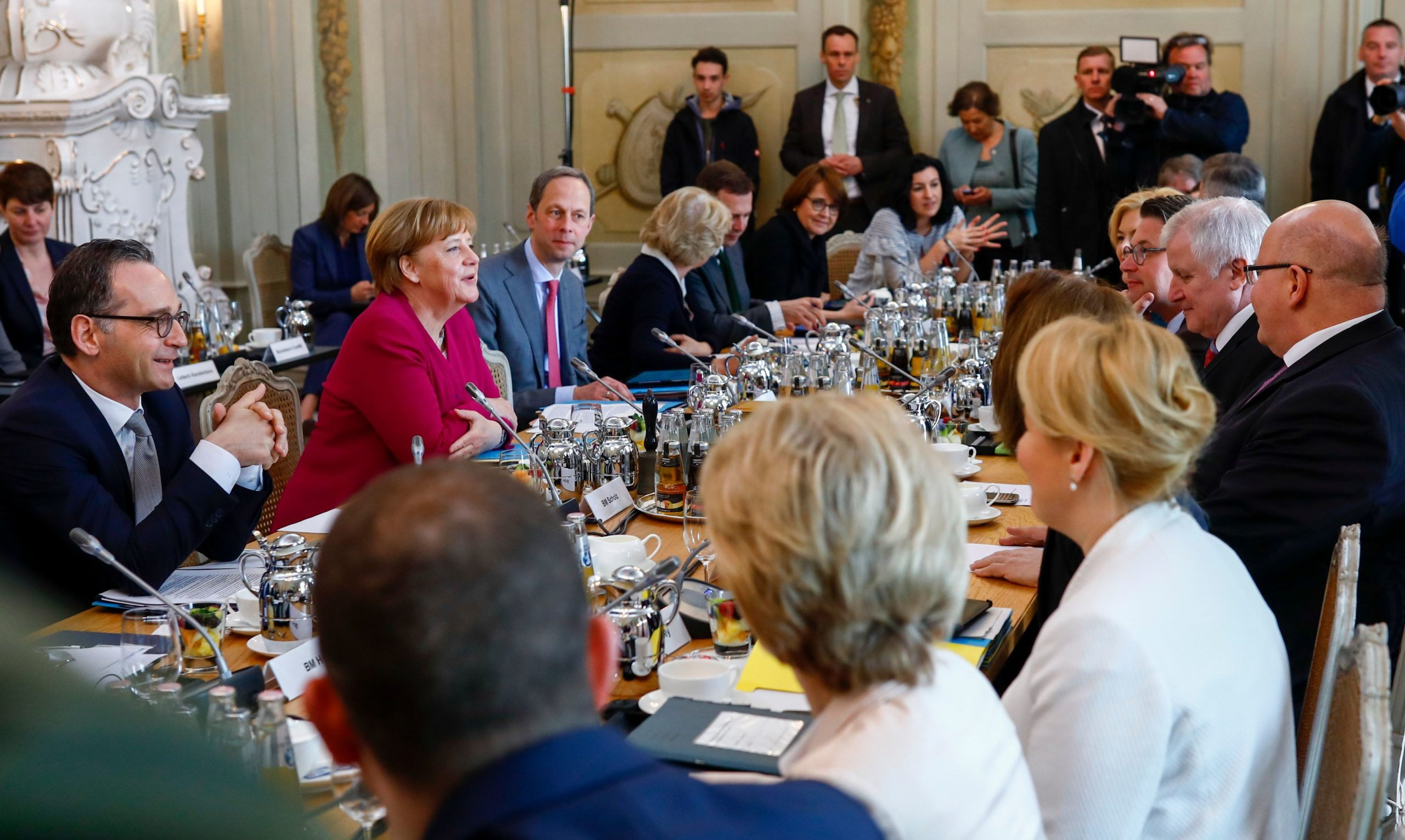 German Chancellor Angela Merkel sits among members of the government ahead of a cabinet meeting on April 11, 2018. (Axel Schmidt/AFP via Getty Images)