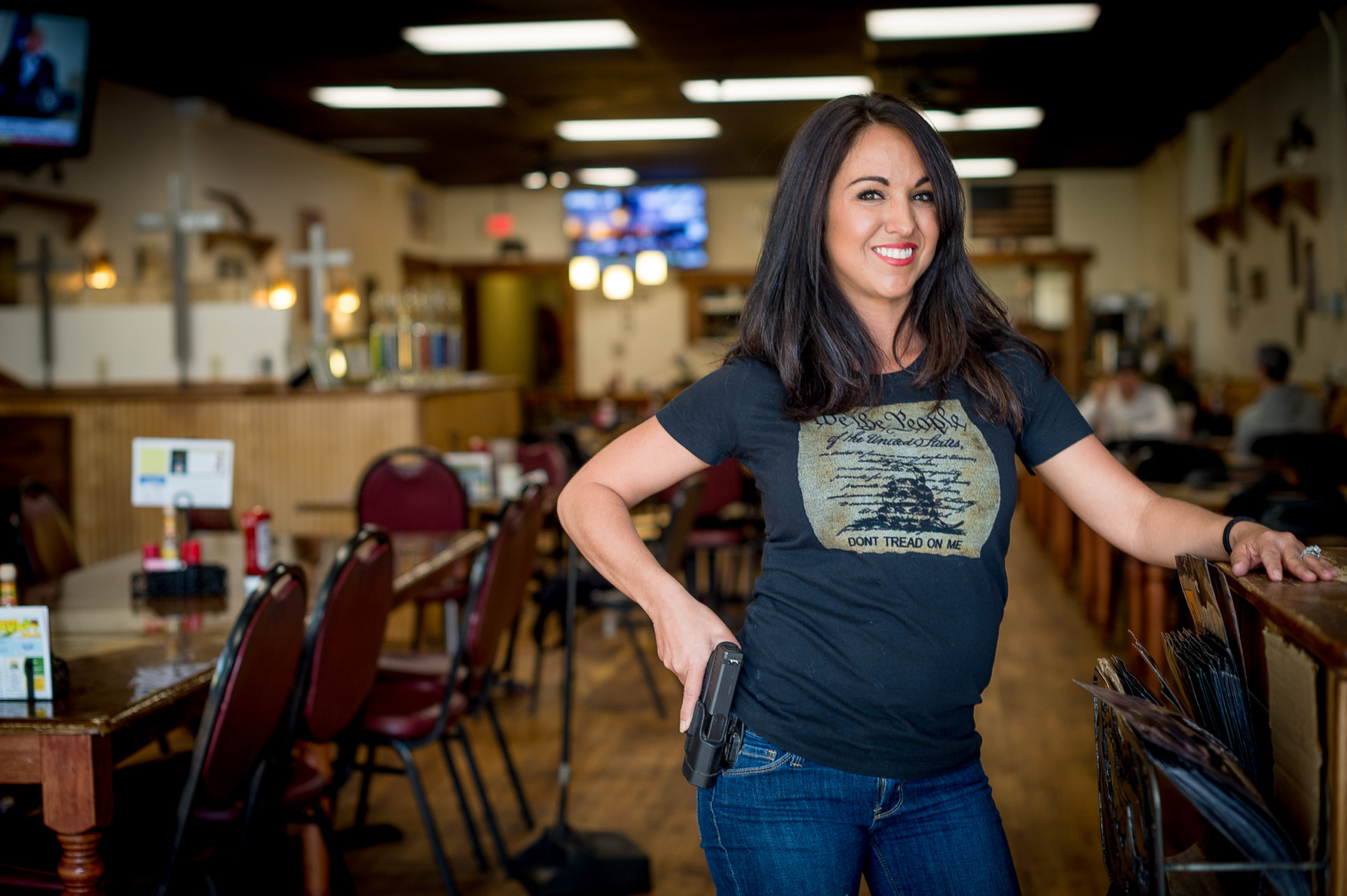 Owner Lauren Boebert poses for a portrait at Shooters Grill in Rifle, Colorado on April 24, 2018. - Lauren Boebert opened Shooters Grill in 2013 with her husband Jason in the small town of Rifle, Colorado, the only city in the United States named after a gun according to them. Shortly after Boebert opened the restaurant, there was a murder in the alley behind it. Boebert went next door to the Tradesmen Gun Store and Pawnshop to speak to the owner, Edward Wilks. Wilks explained to her that you dont need a permit in the state of Colorado to open carry. The next day she started carrying a gun with her. The majority of her staff carries, while it is not a requirement to work there she encourages them to do so if they feel comfortable with it. Customers are also welcome to carry firearms on them as well. The restaurants theme remained heavily country western but revolves alot around the theme of the Second Amendment as well. (EMILY KASK/AFP via Getty Images)