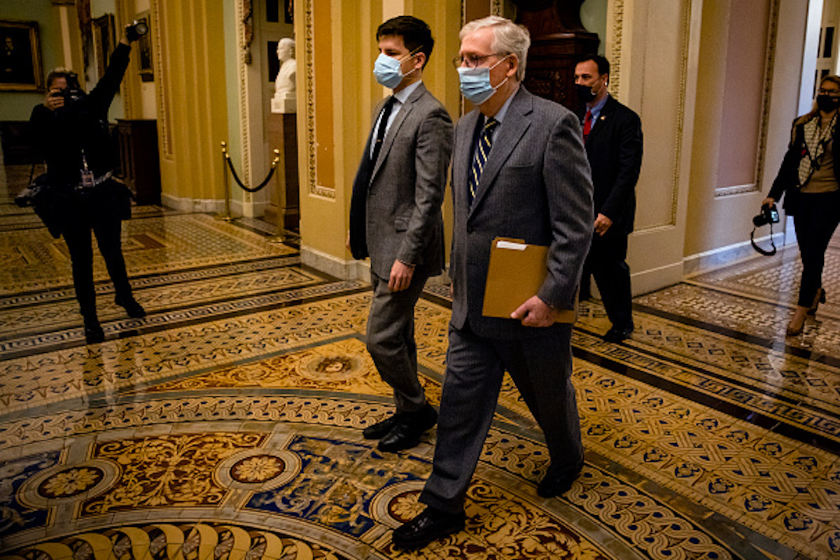 WASHINGTON, DC - JANUARY 26: Senate Minority Leader Mitch McConnell (R-KY) heads to the Senate floor before being called into session on January 26, 2021 in Washington, DC. Today senators will be sworn in as the jury for the second impeachment trial of former President Donald Trump. Senate President pro tempore Patrick Leahy (D-VT) will preside over the trial in place of Supreme Court Chief Justice John Roberts. (Photo by Samuel Corum/Getty Images)