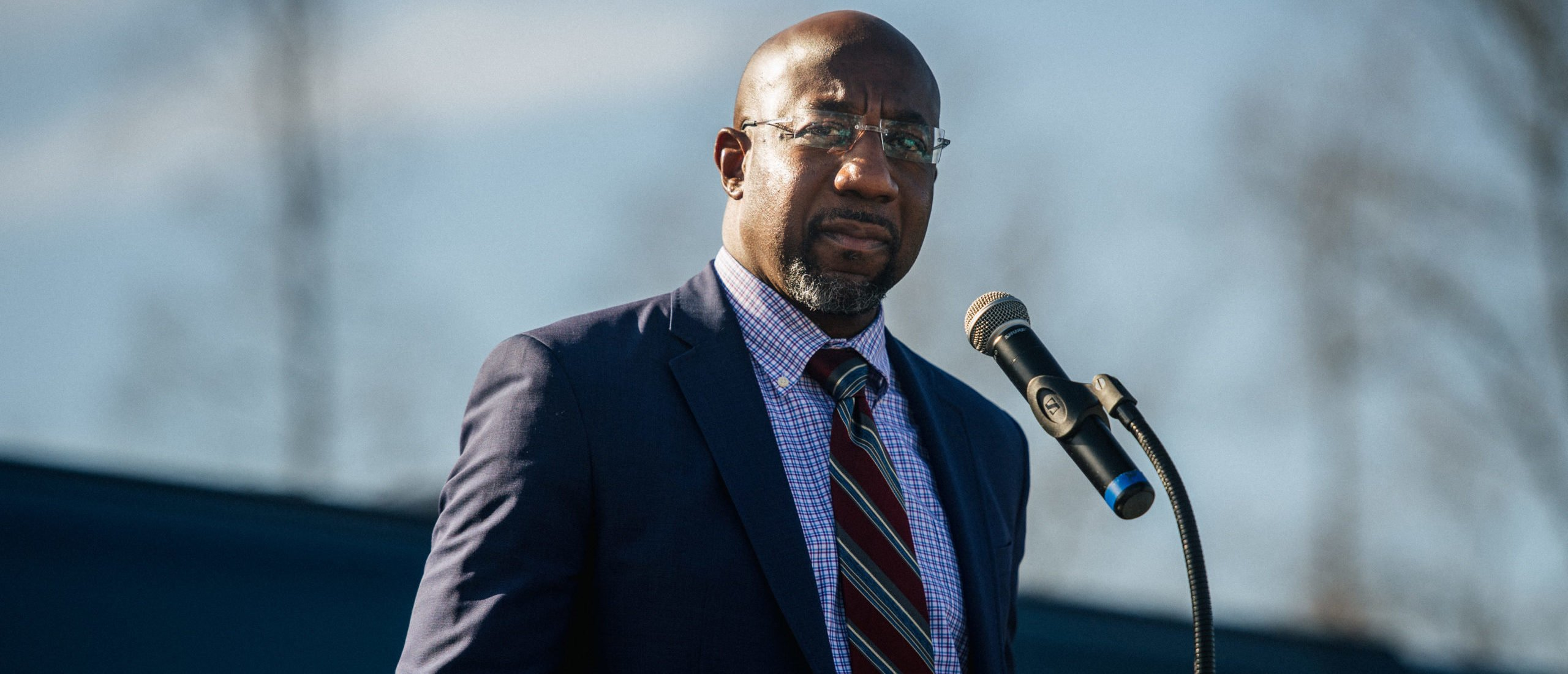 RIVERDALE, GA - JANUARY 04: Georgia Democratic Senate candidate Rev. Raphael Warnock speaks at a drive-in rally on January 4, 2021 in Riverdale, Georgia. In the lead-up to the January 5 runoff election, Democratic Senate candidate Rev. Raphael Warnock continues to focus on voting efforts across the state of Georgia. (Photo by Brandon Bell/Getty Images)