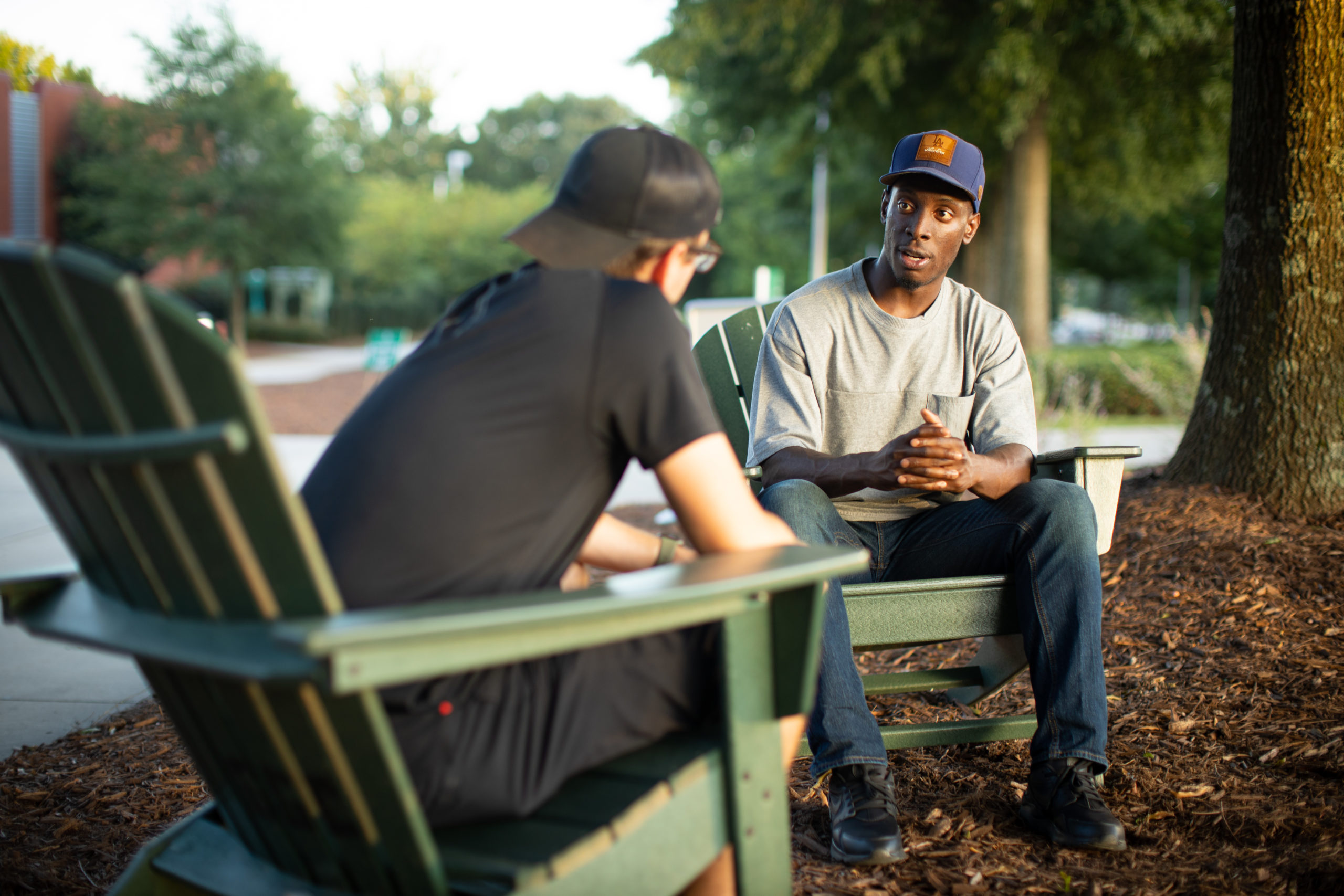 Chike Uzuegbunam (right) speaks to another student on the campus of Georgia Gwinnett College in Lawrenceville, Georgia. (Alliance Defending Freedom)