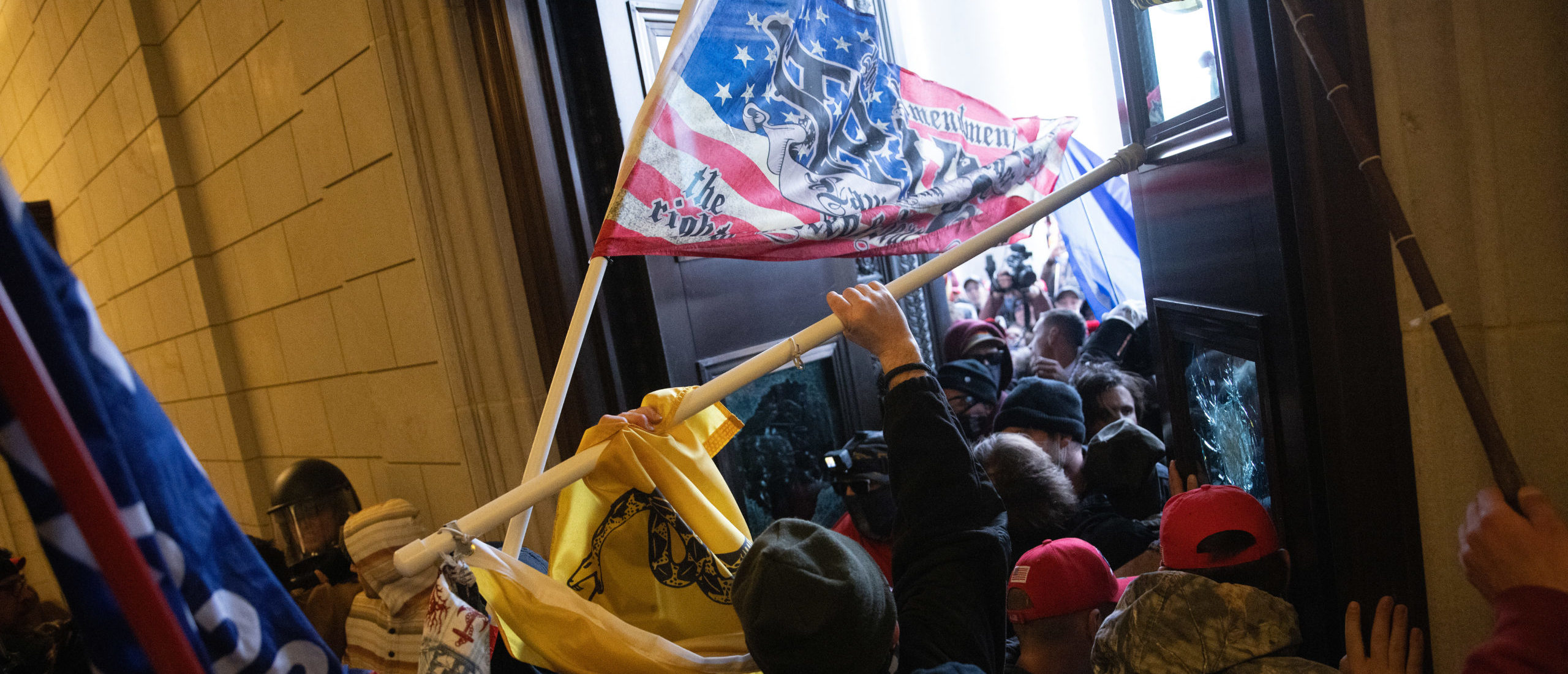WASHINGTON, DC - JANUARY 06: A pro-Trump mob breaks into the U.S. Capitol on January 06, 2021 in Washington, DC. (Photo by Win McNamee/Getty Images)