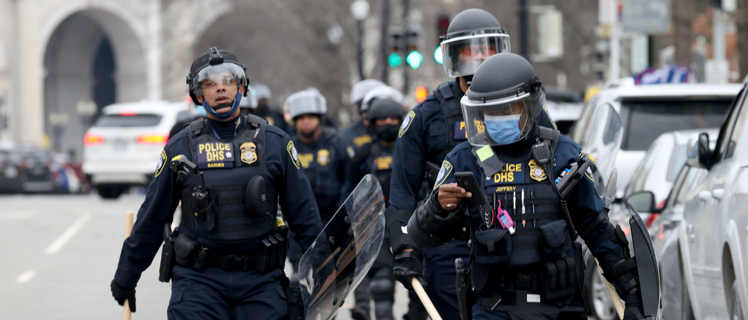 WASHINGTON, DC - JANUARY 06: Police officers in riot gear walks towards the U.S. Capitol as protesters enter the building on January 06, 2021 in Washington, DC. Trump supporters gathered in the nation's capital today to protest the ratification of President-elect Joe Biden's Electoral College victory over President Trump in the 2020 election. (Photo by Tasos Katopodis/Getty Images)